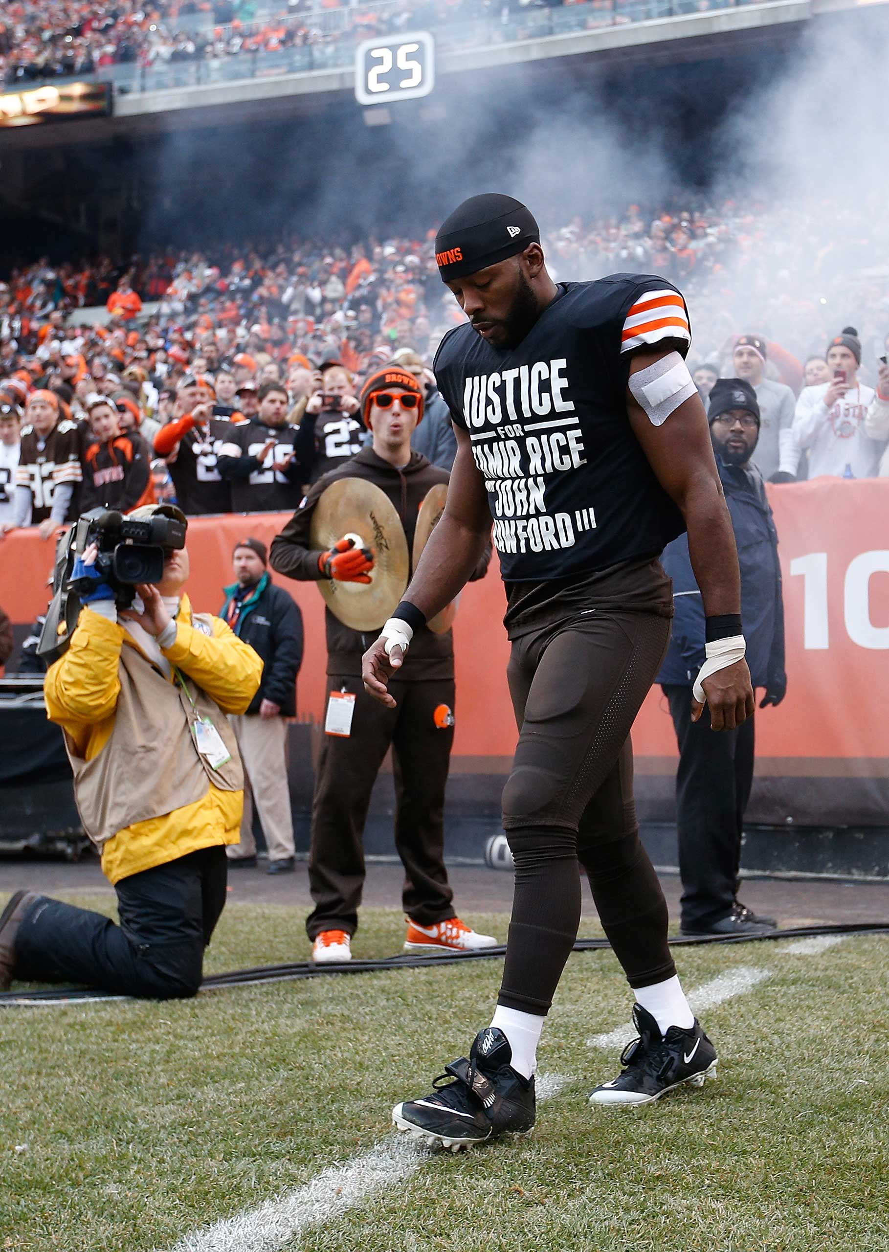 Andrew Hawkins #16 of the Cleveland Browns walks onto the field while wearing a protest shirt during introductions prior to the game against the Cincinnati Bengals at FirstEnergy Stadium in Cleveland on Dec. 14, 2014.