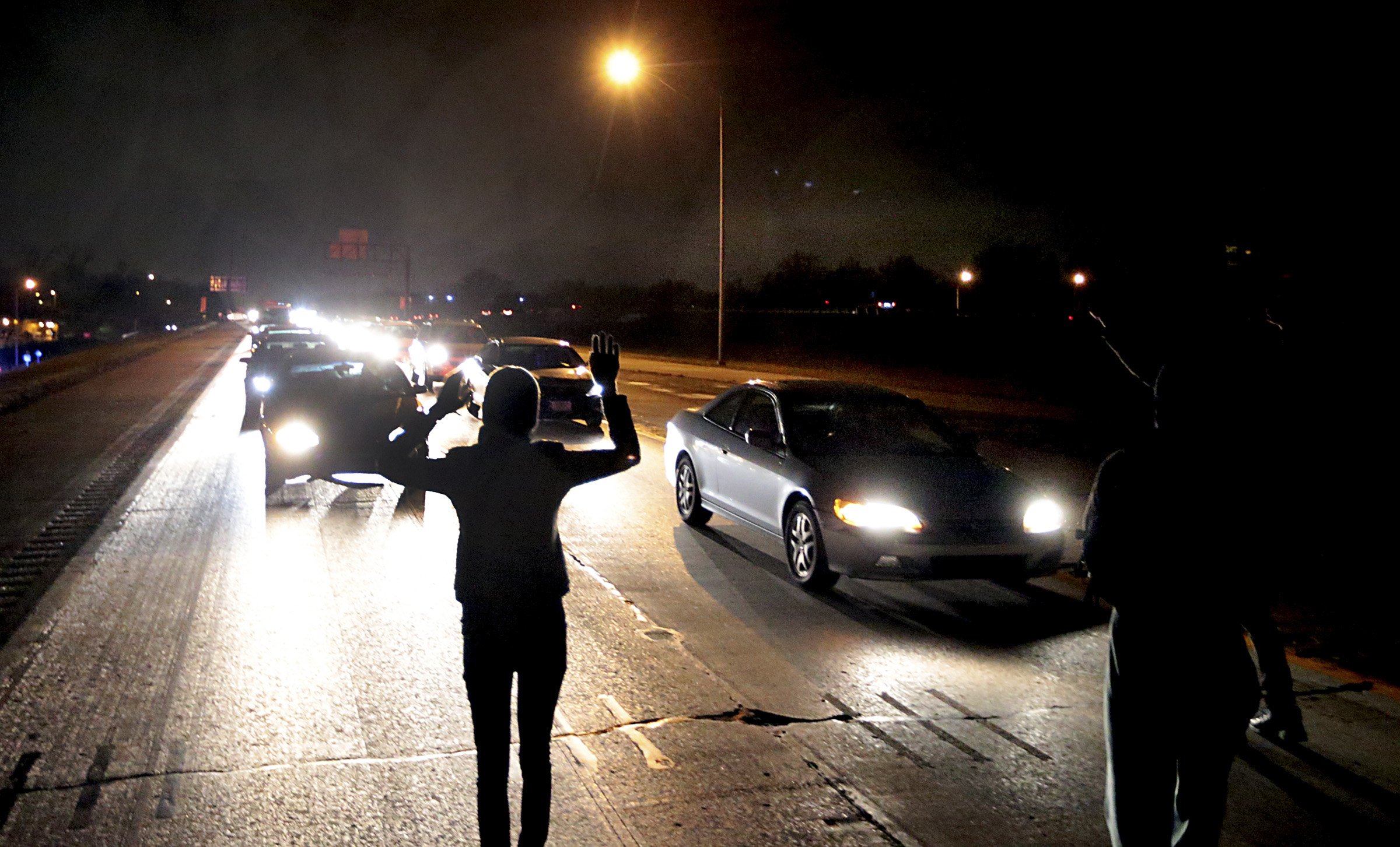 Protesters shut down an interstate at Airport Road on Dec. 24, 2014, in Berkeley, Mo.