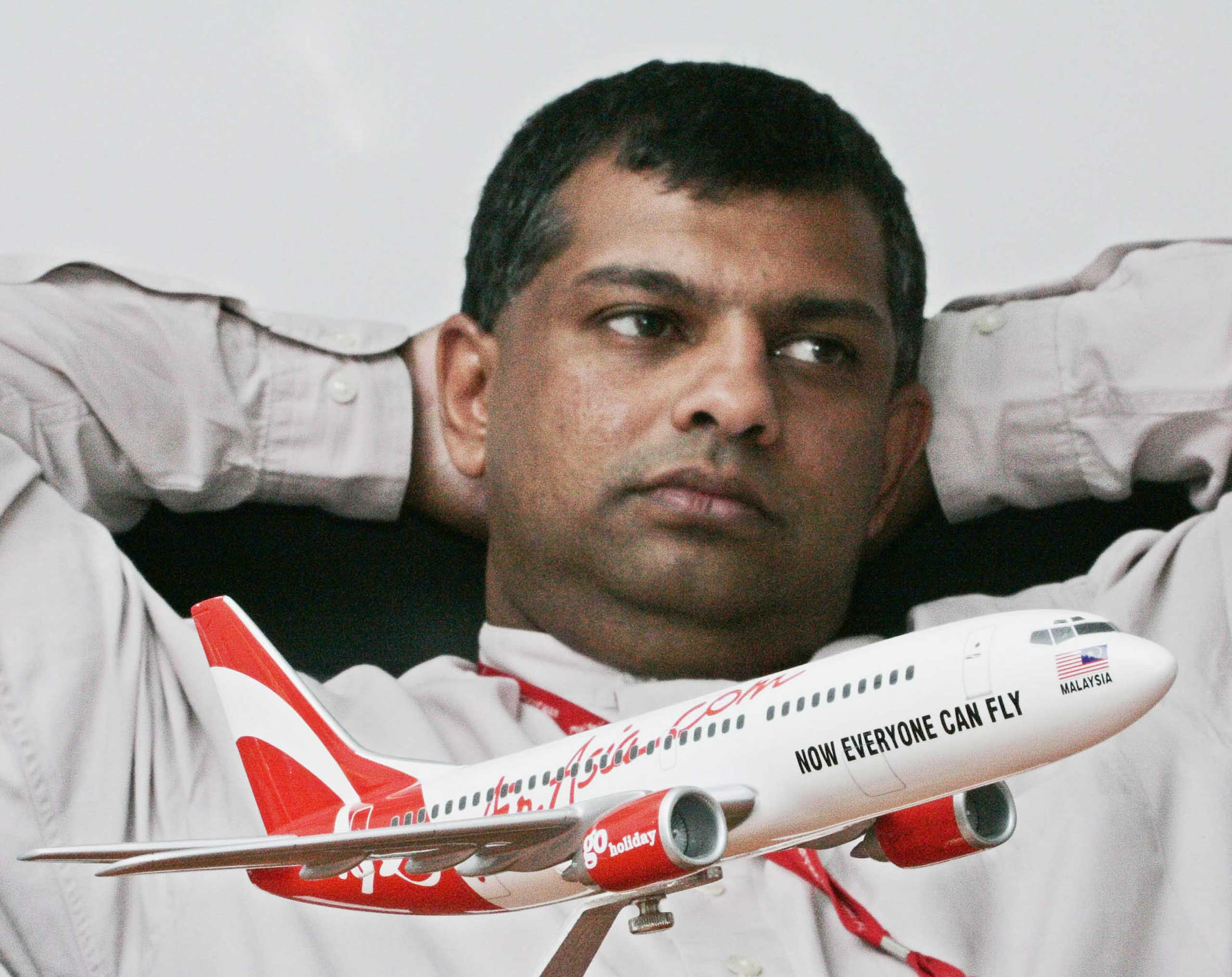 Tony Fernandes, AirAsia's Chief Executive, looks on during an interview at his office in Kuala Lumpur International Airport in Sepang, Malaysia, Aug, 9, 2005. Purchased in December of 2001 by Fernandes, AirAsia pioneered low-cost travel in Asia.