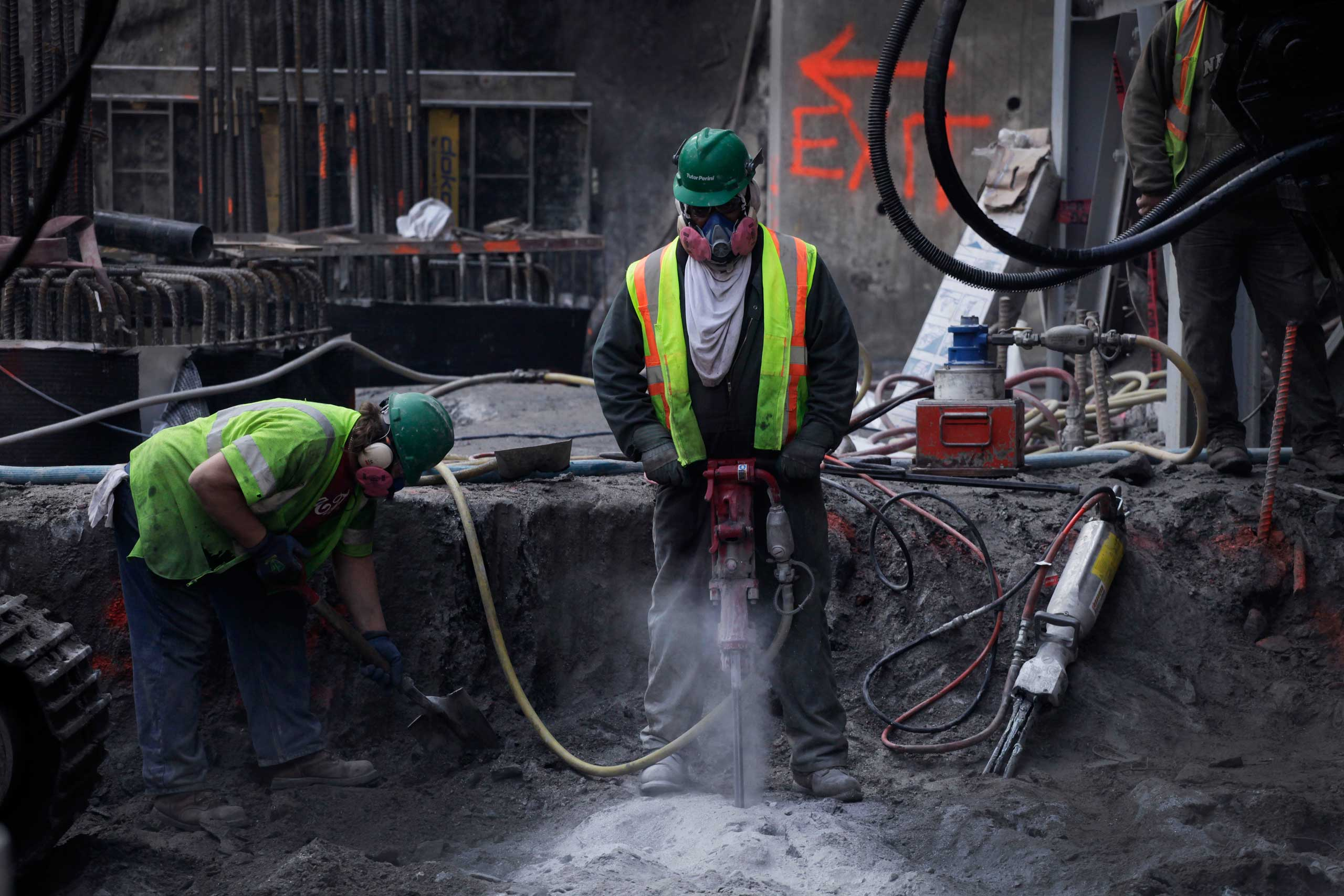 A worker uses a pneumatic jackhammer to drill rock at the foundation for the World Trade Center's transportation hub, Nov. 10, 2011 in New York.