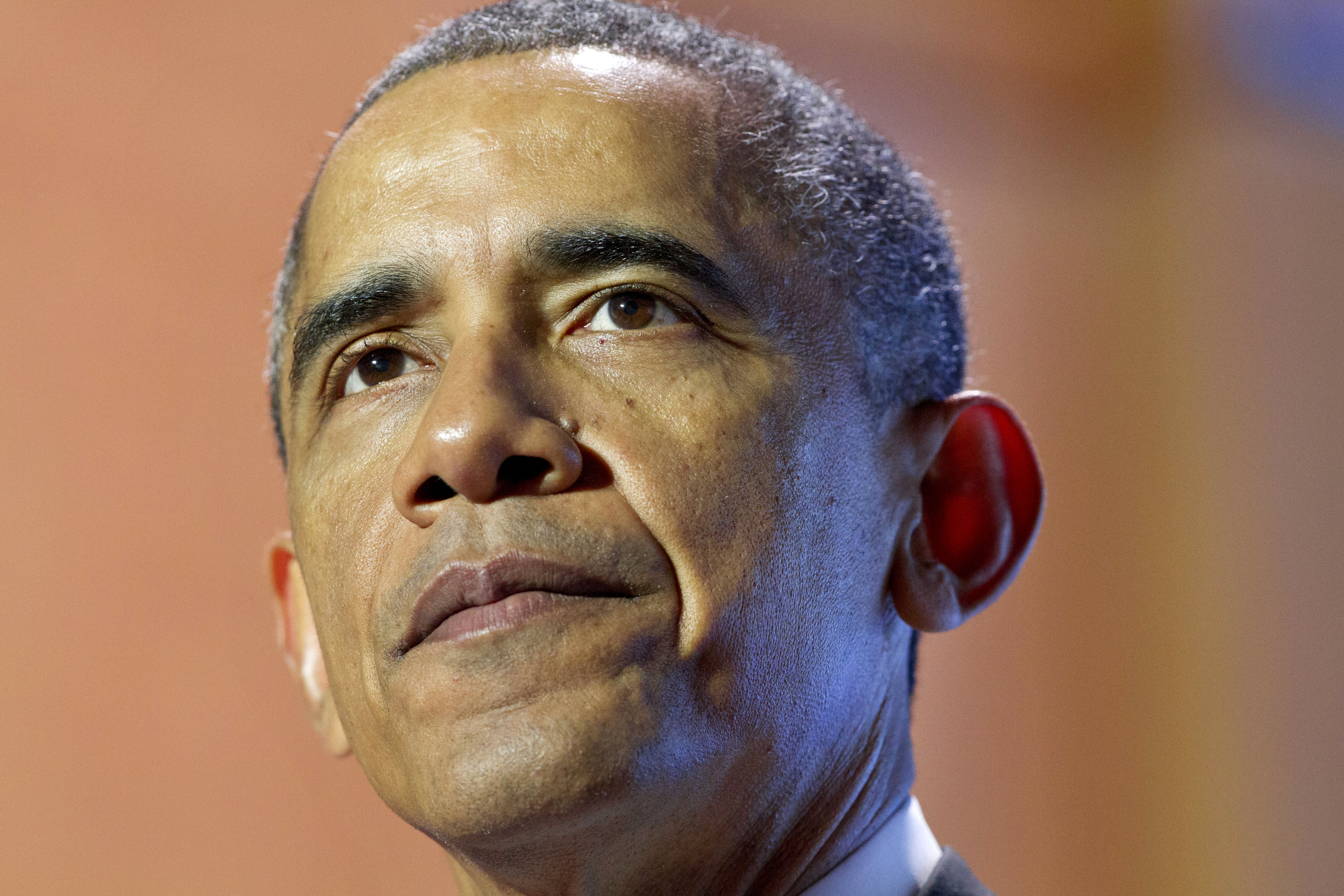 President Barack Obama pauses while speaking at the Summit on College Opportunity