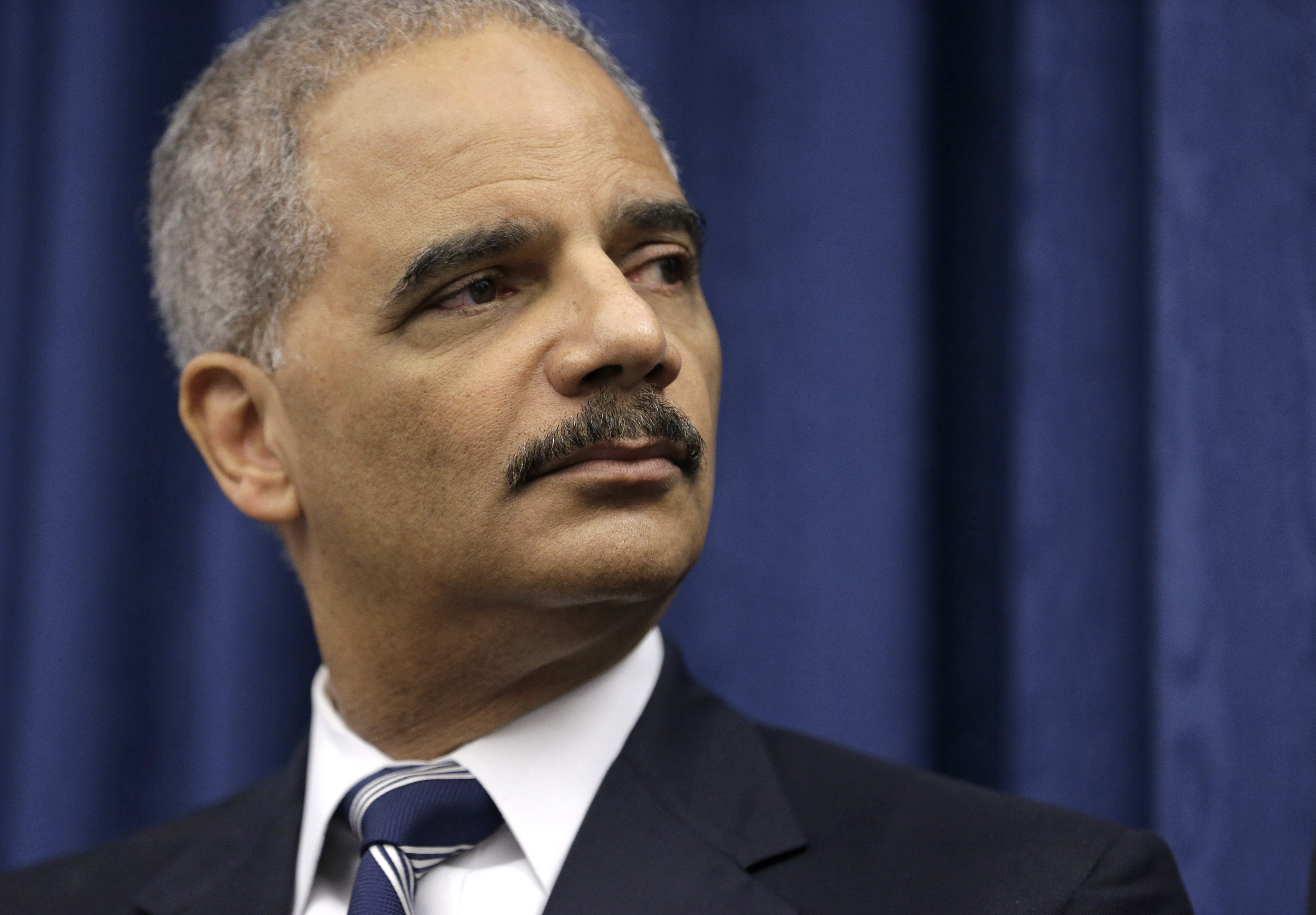 In this Thursday, Dec. 4, 2014, file photo, U. S. Attorney General Eric Holder speaks during a news conference before a roundtable meeting in Cleveland.