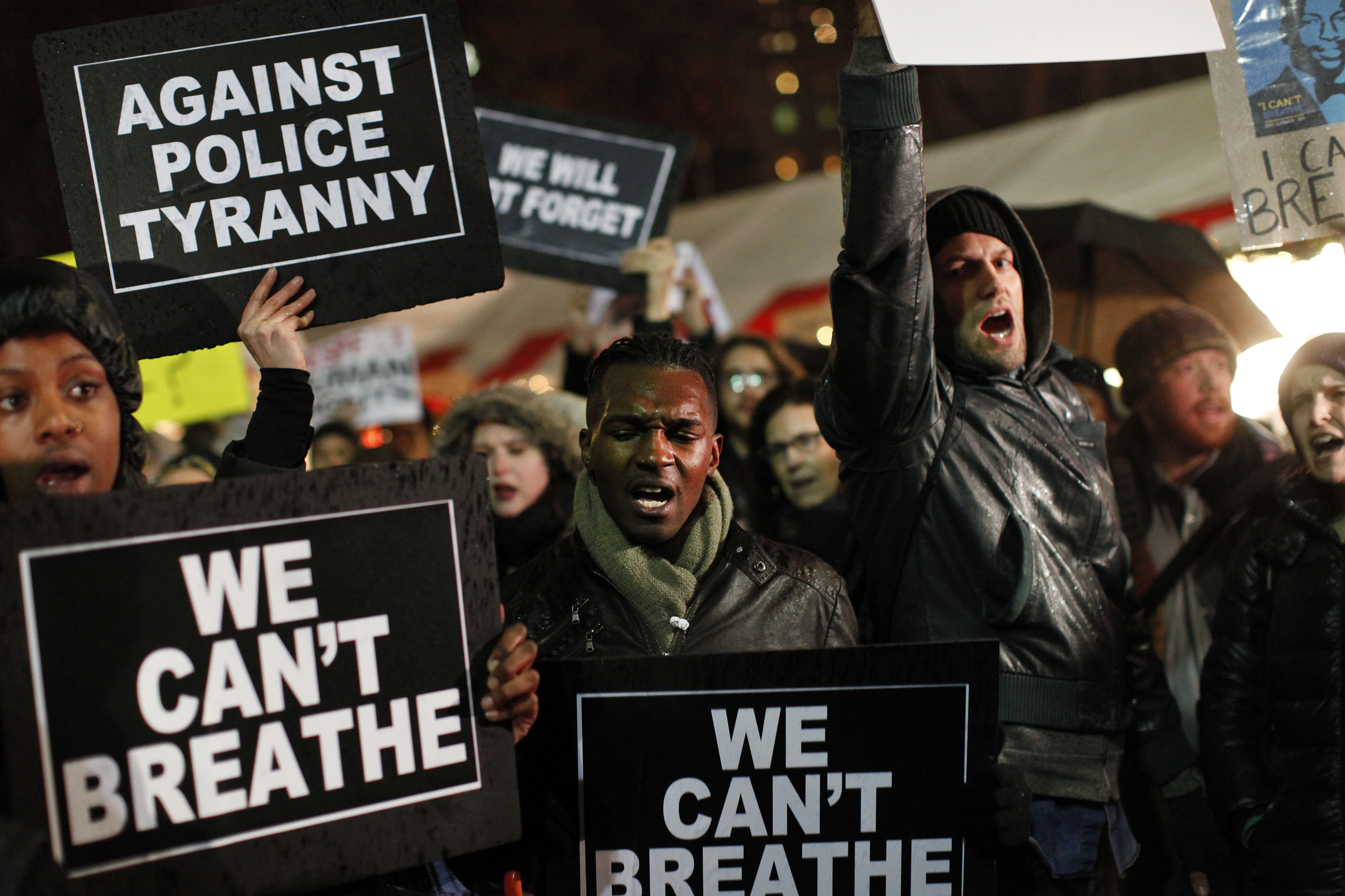 Protesters rallying against a grand jury's decision not to indict the police officer involved in the death of Eric Garner gather in Columbus Circle, Friday, Dec. 5, 2014, in New York.