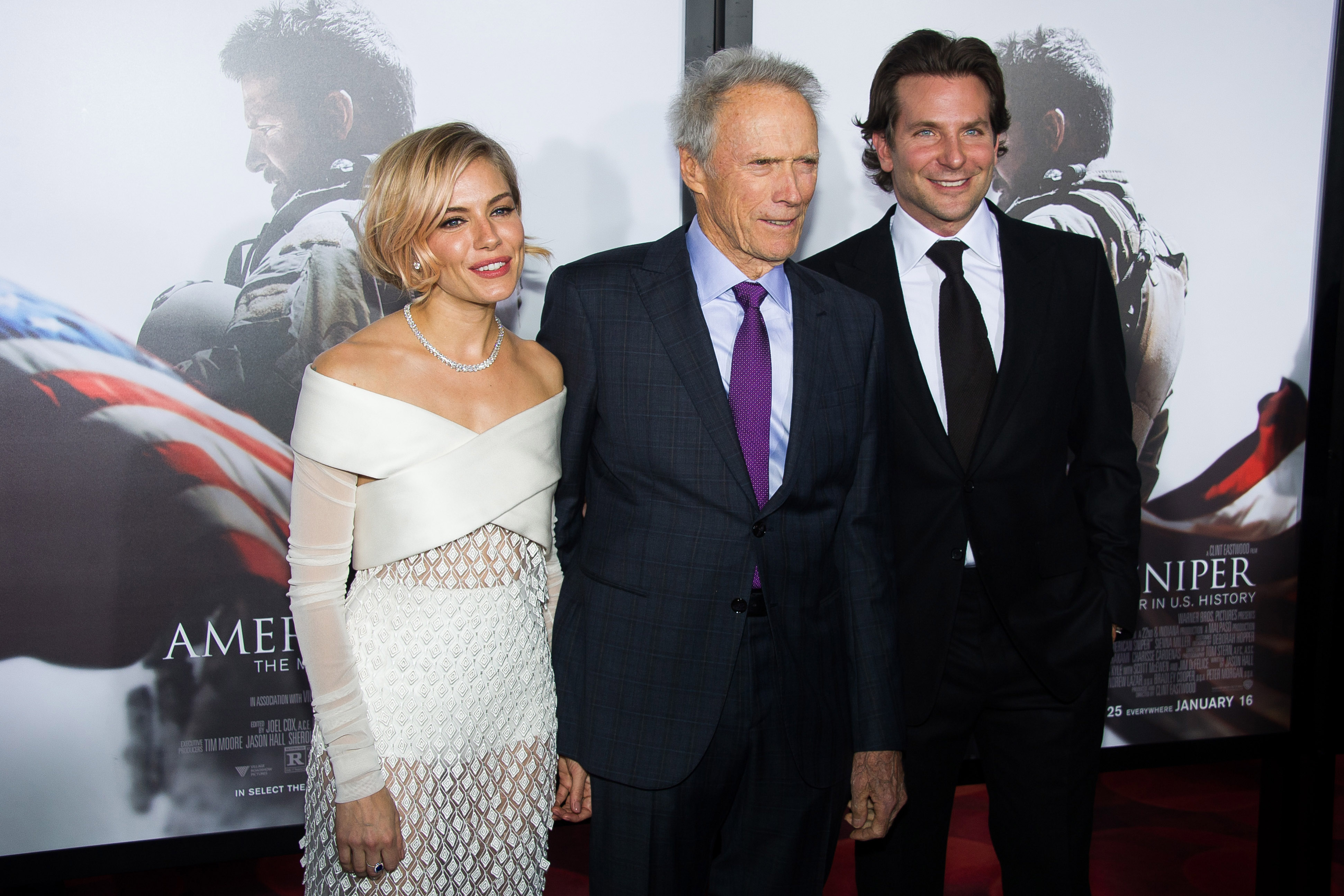 Sienna Miller, from left, Clint Eastwood and Bradley Cooper attend the  American Sniper  premiere on Monday, Dec. 15, 2014 in New York. (Photo by Charles Sykes/Invision/AP)