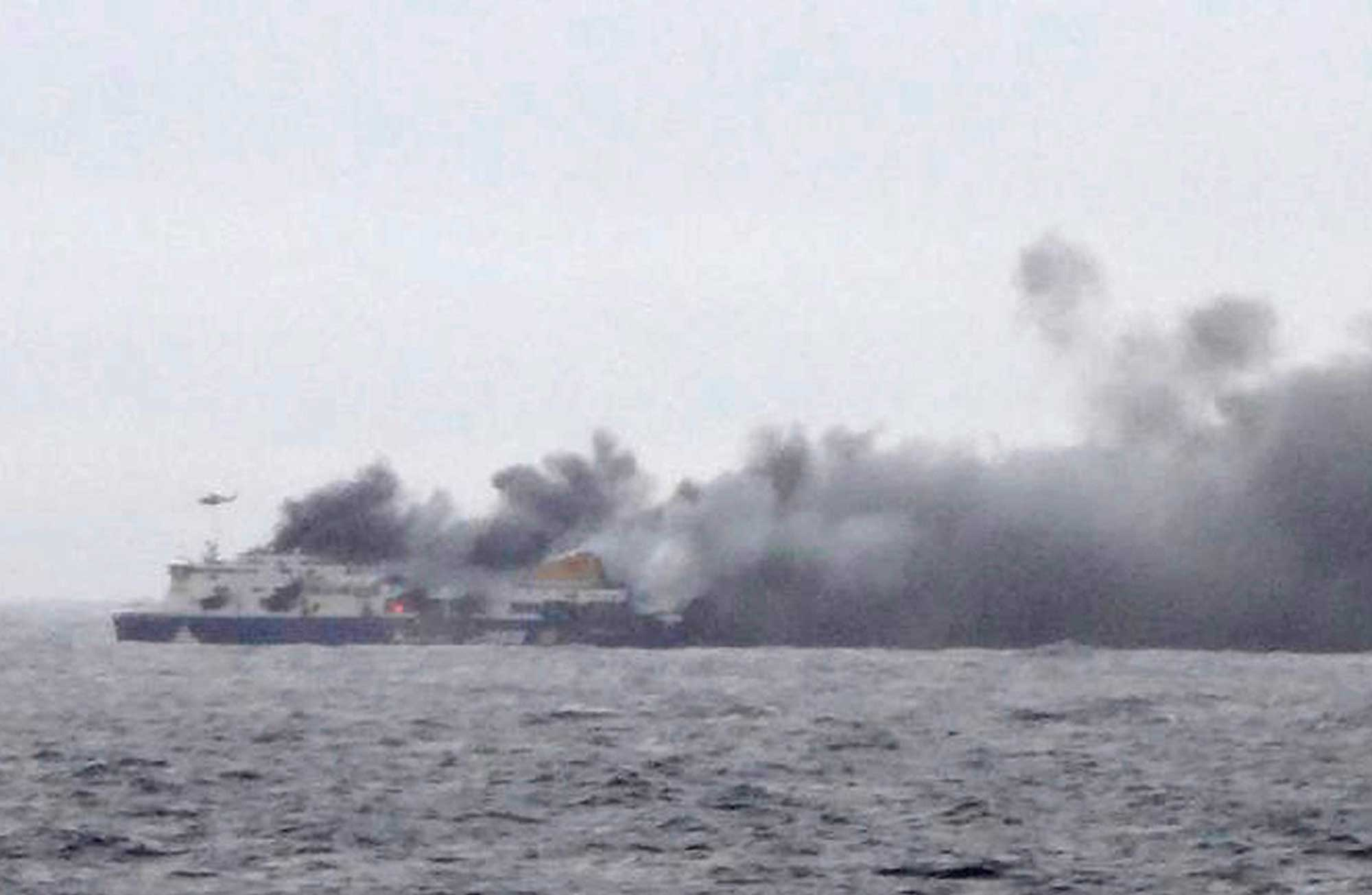In this photo taken from a nearby ship, smoke rises from the Italian-flagged Norman Atlantic after it caught fire in the Adriatic Sea, Dec. 28, 2014.
