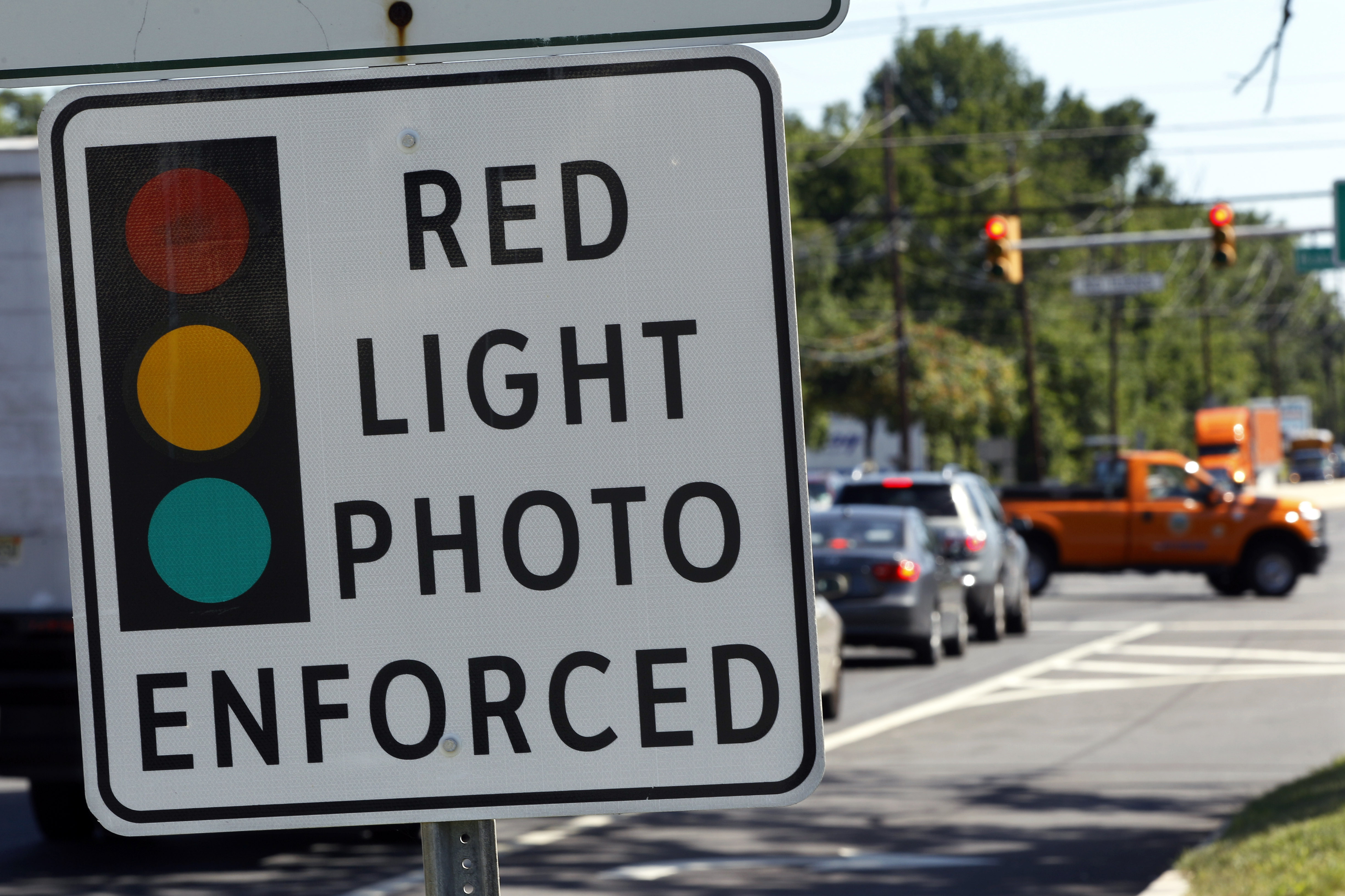 A red light photo enforcement sign is seen on Route 1 in Lawrence Township on July 25, 2012. New Jersey's red light camera pilot program will end Dec. 16, 2014.