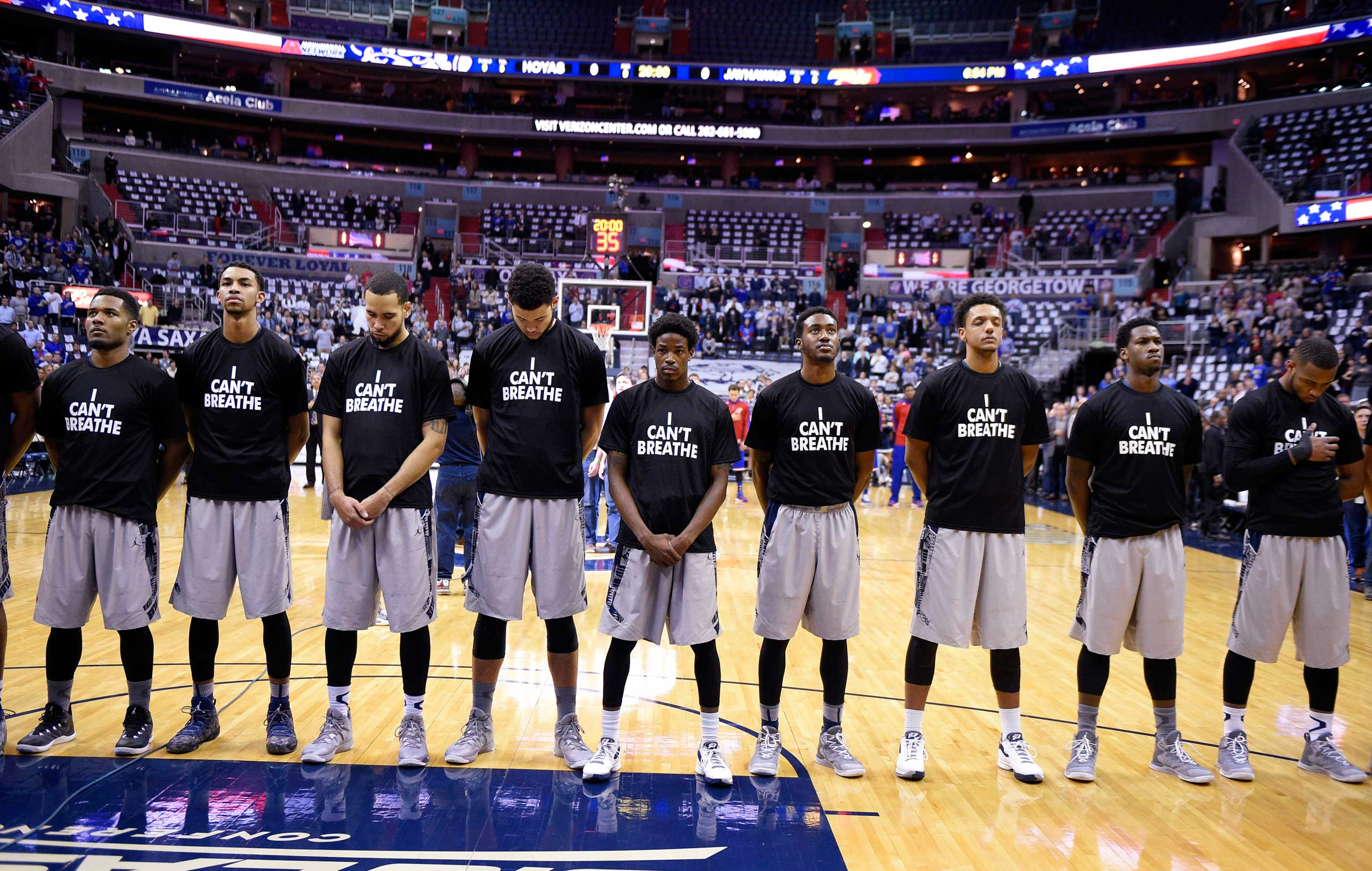 Members of the Georgetown basketball team, wearing  I Can't Breathe  t-shirts, stand for the national anthem before an NCAA college basketball game against Kansas in Washington, Dec. 10, 2014.