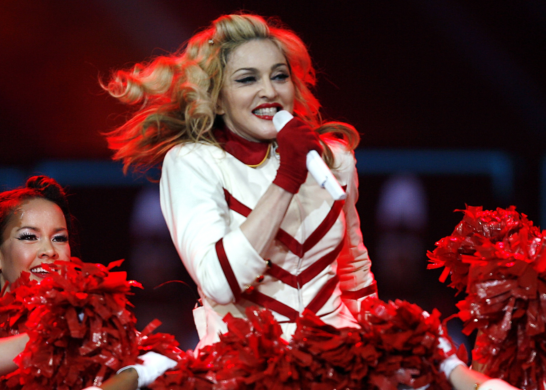 FILE - In this Nov. 8, 2012, file photo, Madonna performs at the Joe Louis Arena in Detroit. Madonna, who was  inspired  during a recent visit to Detroit, is donating money toward the construction of a new youth boxing gym and buying iPods, iPads and other supplies for students at a charter school in her hometown, according to a news release issued by the music icon's publicist Monday, June 30, 2014. The statement said Madonna's donations to three Detroit organizations represent  the first phase of a long-term commitment to  the city. (Photo by Gary Malerba/Invision/AP, file)