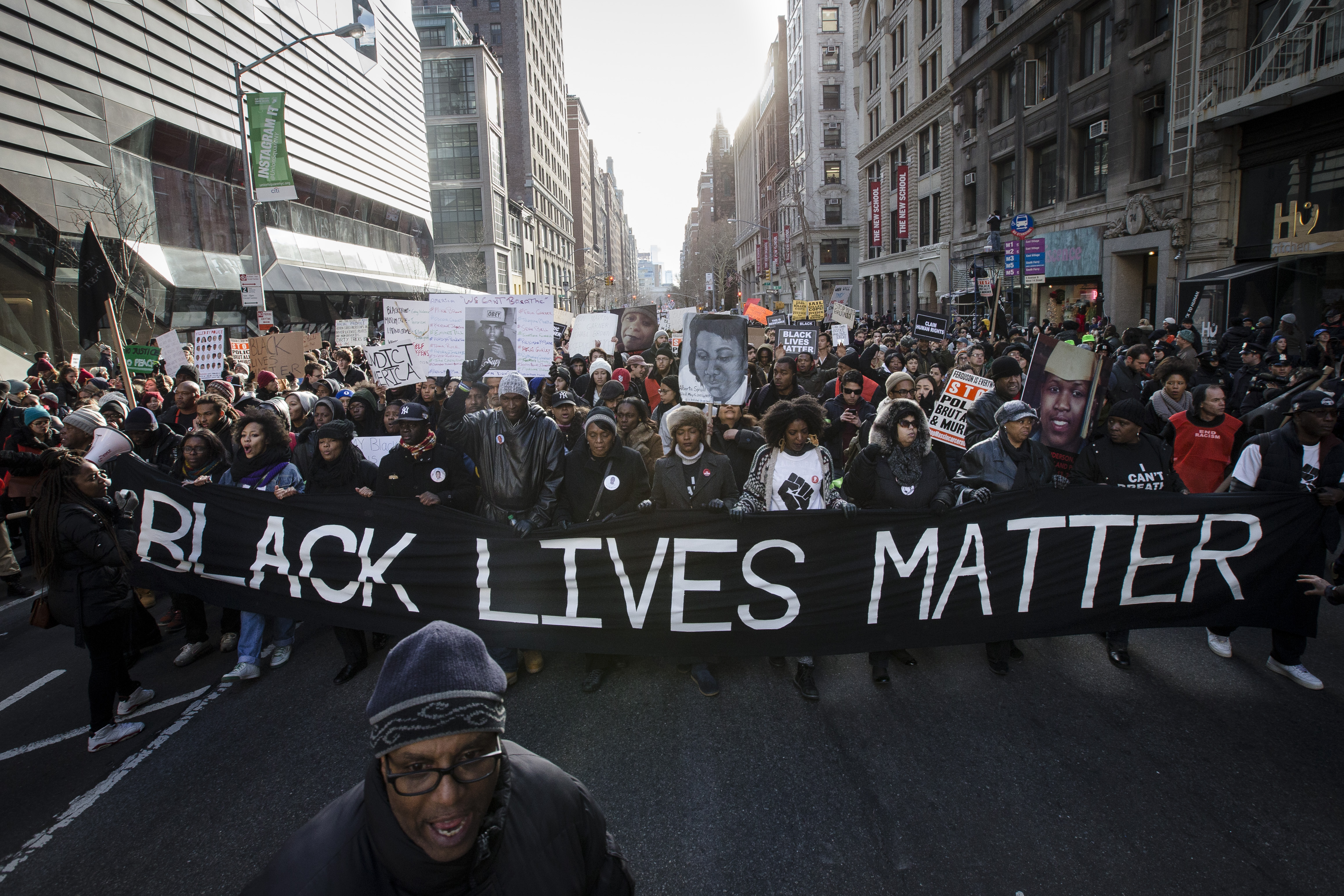Demonstrators march in New York, Saturday, Dec. 13, 2014, during the Justice for All rally and march. In the past three weeks, grand juries have decided not to indict officers in the chokehold death of Eric Garner in New York and the fatal shooting of Michael Brown in Ferguson, Mo. The decisions have unleashed demonstrations and questions about police conduct and whether local prosecutors are the best choice for investigating police.