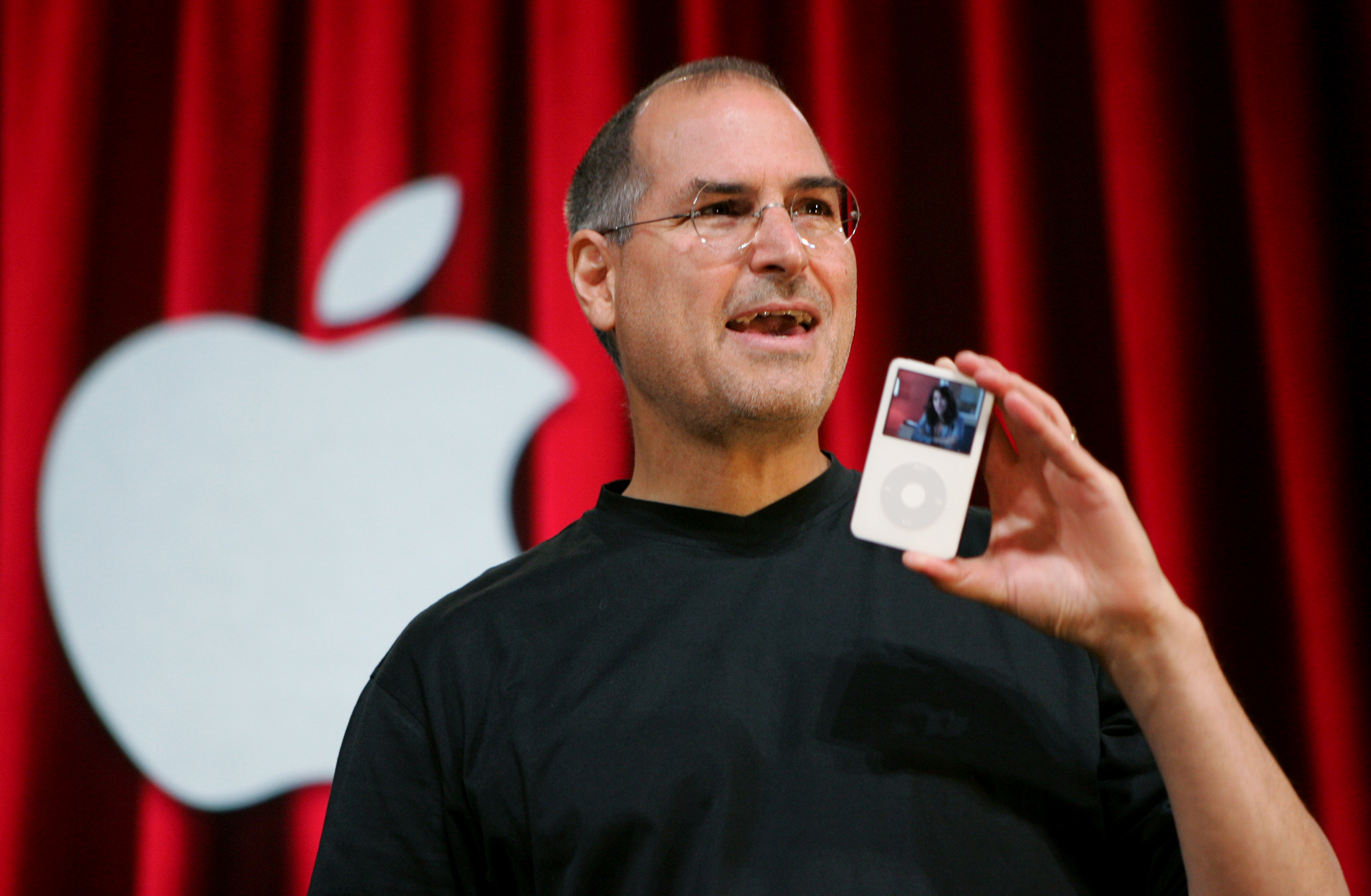 The late Apple CEO Steve Jobs holds up an iPod during an event in San Jose, Calif. on Oct. 12, 2005.