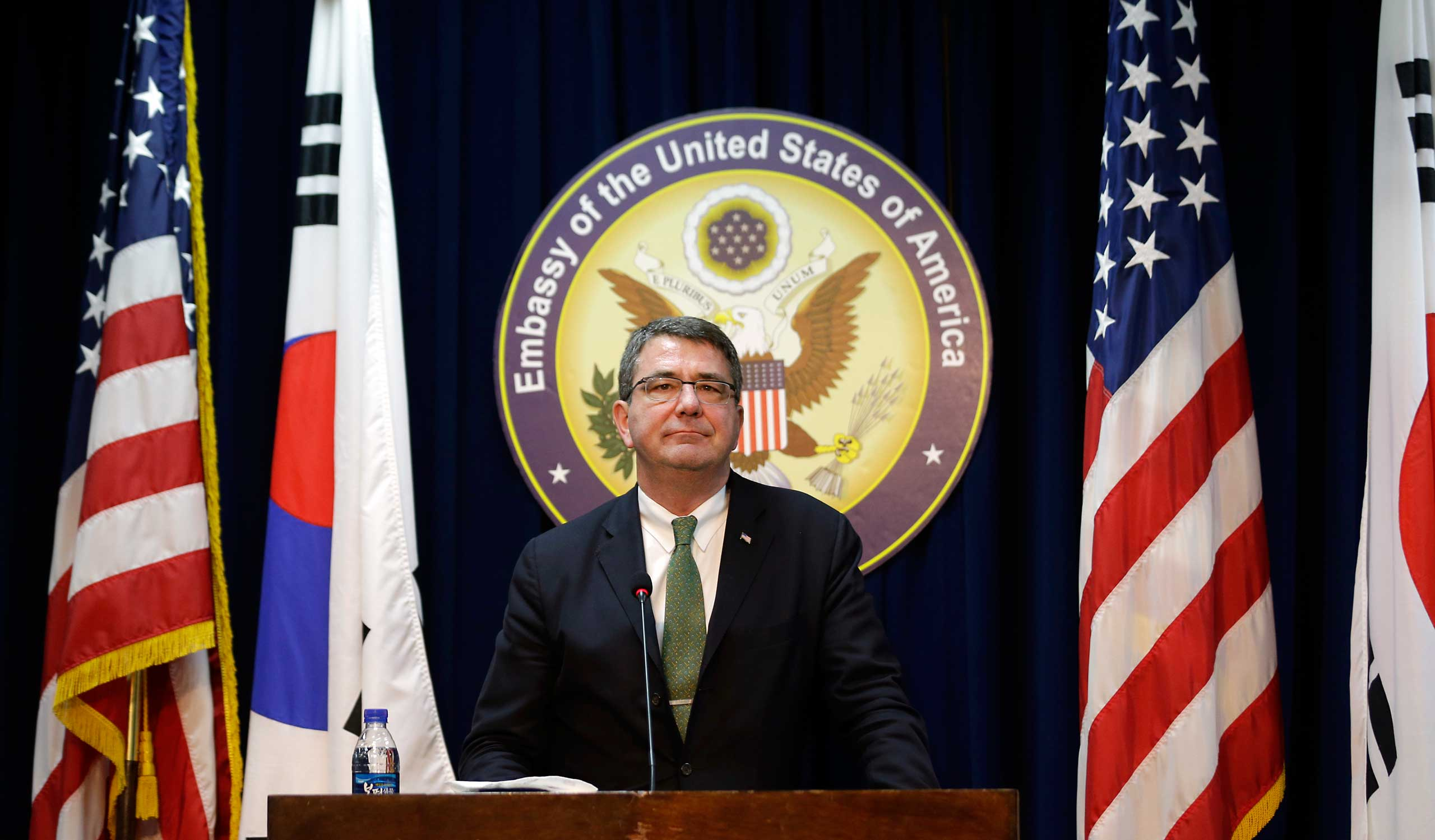 U.S. Deputy Secretary of Defense Ashton Carter listens to reporters' question during a news conference at the U.S. Embassy in Seoul on March 18, 2013.