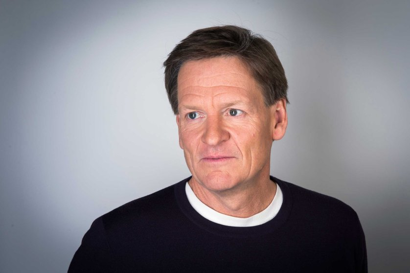 "Author Michael Lewis poses for a portrait while promoting his book about high-frequency trading (HFT) named ""Flash Boys: A Wall Street Revolt,"" in New York"