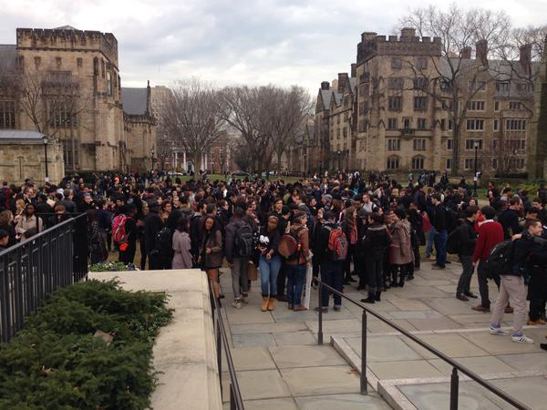 Heidi Knoblauch, a Yale historian, posted this picture saying,  I'm sure lots of other people took better pictures than this, but here is a glimpse of #HandsUpWalkout @Yale  http://t.co/76kUiy47Se