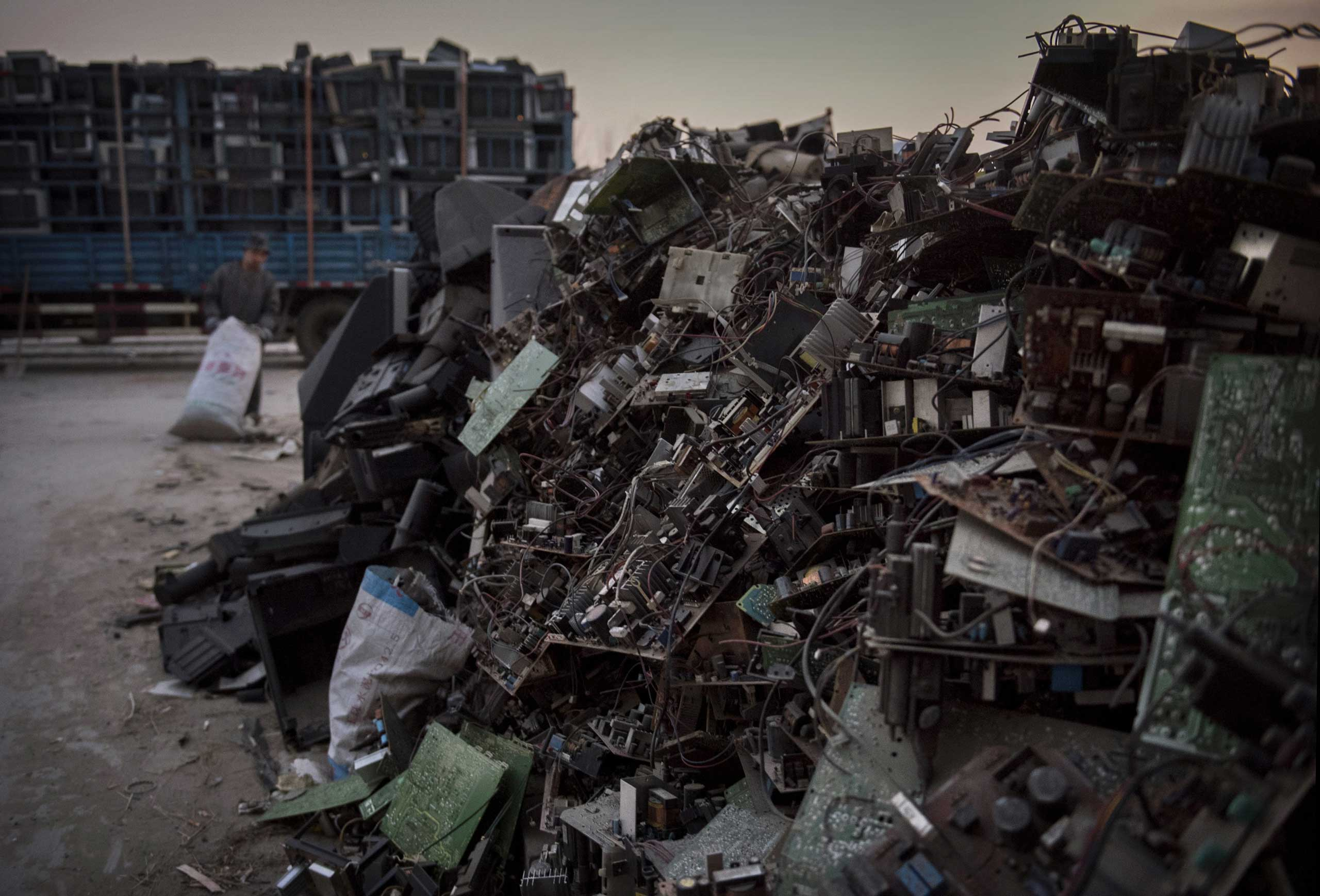 Discarded computer and electronics parts wait to be recycled in the Dong Xiao Kou village on Dec. 11, 2014 in Beijing.