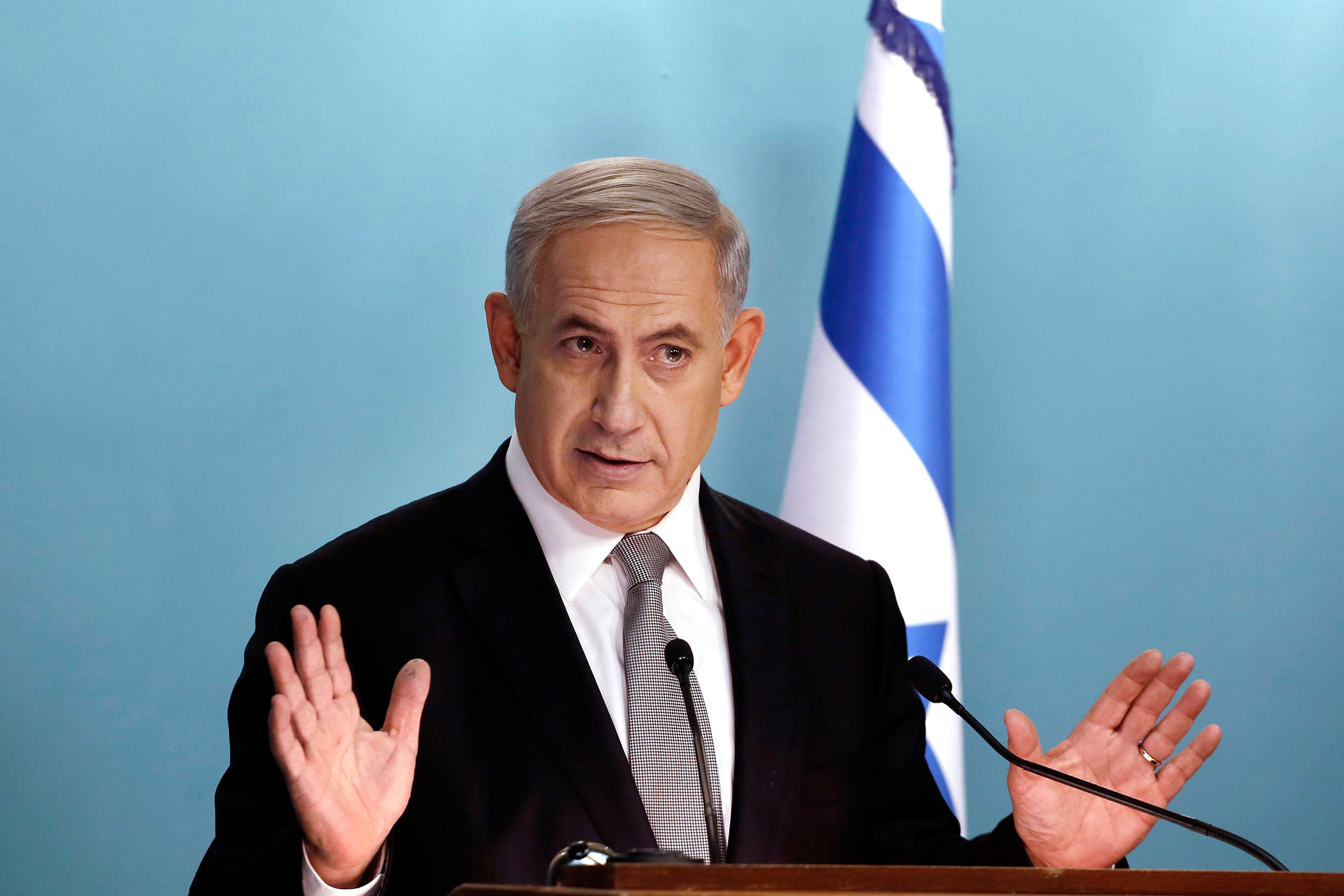 Israeli Prime Minister Benjamin Netanyahu speaks during a news conference at his office in Jerusalem on December 2, 2014.