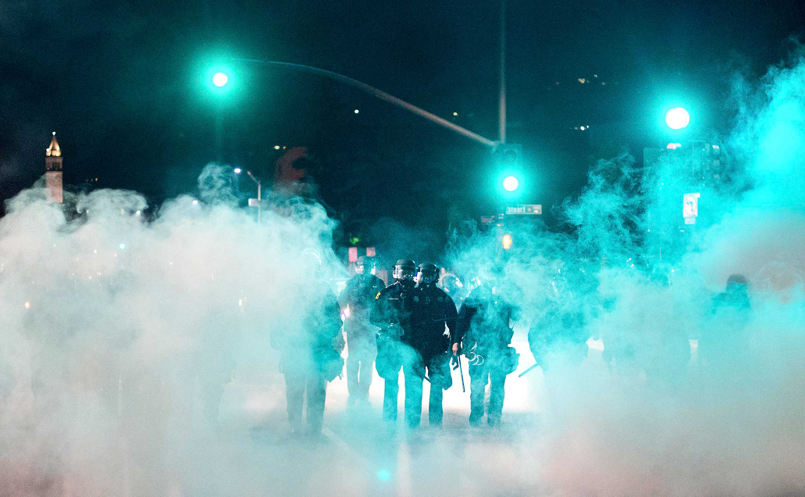 Police officers deploy teargas while trying to disperse a crowd comprised largely of student protesters during a protest against police violence in Berkeley, Calif. on Dec. 7, 2014.