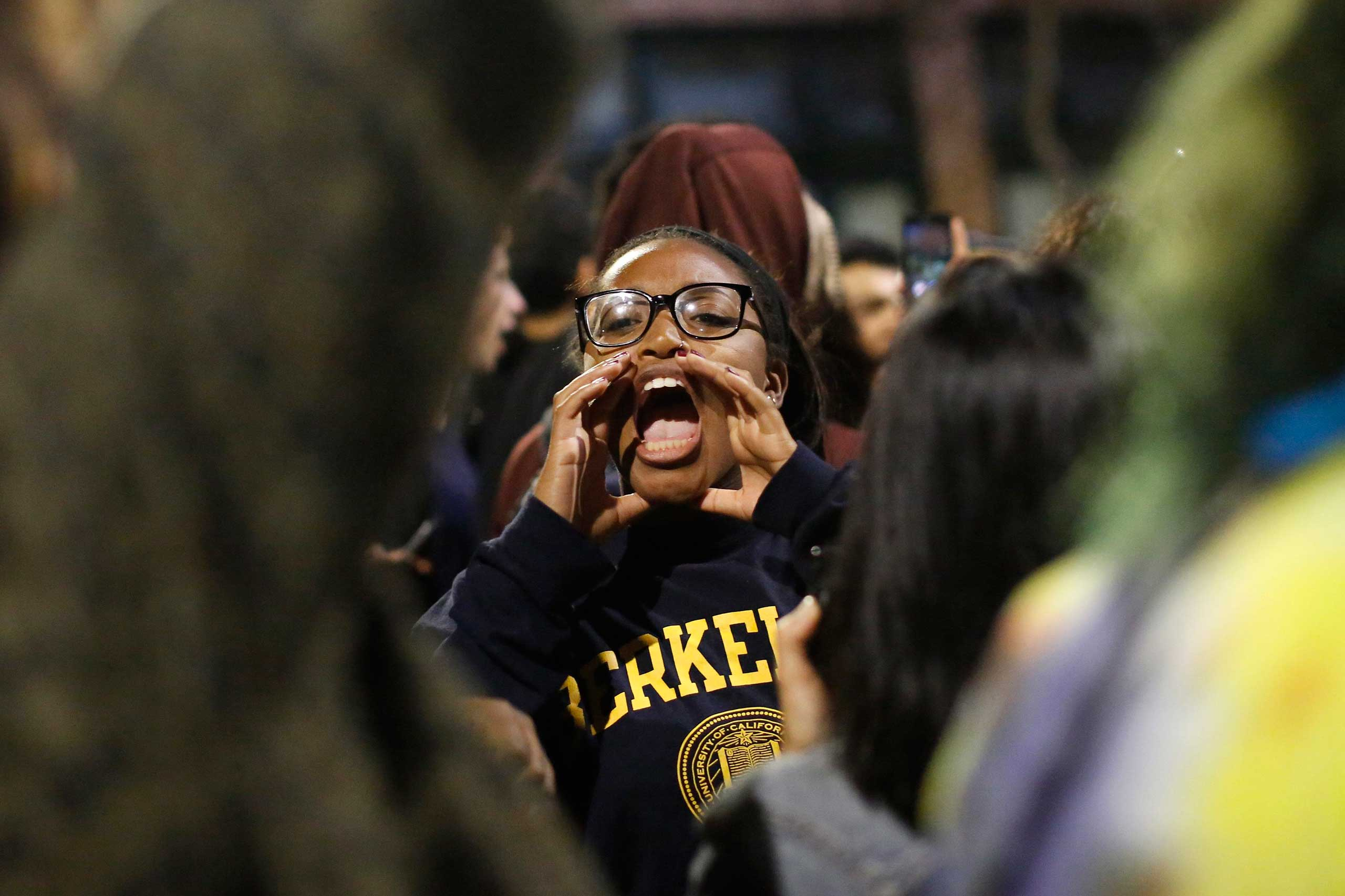 A protester chants during a march against the grand jury decision to not indict a police officer in the death of Eric Garner, in Berkeley, Calif., Dec. 7, 2014.