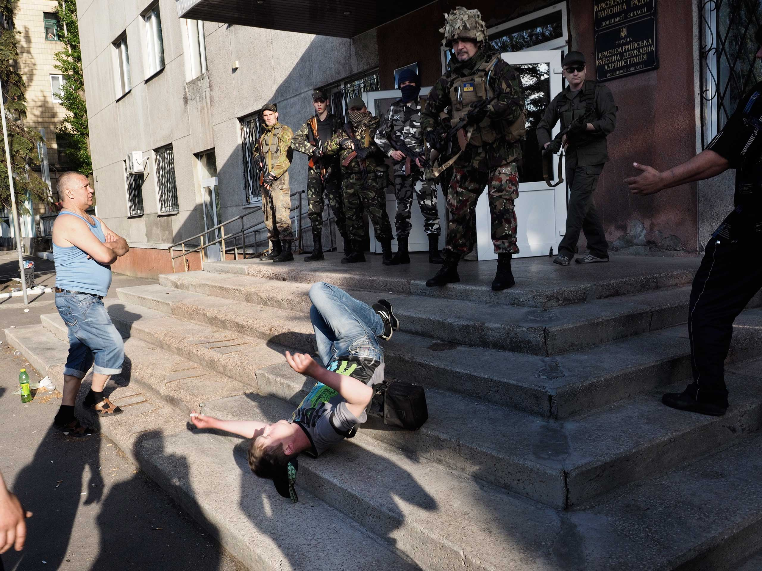 Around 12 armed men identified as members of the Ukrainian national guard opened fire on the voters outside the town hall in Krasnoarmeisk, Ukraine, May 11, 2014.