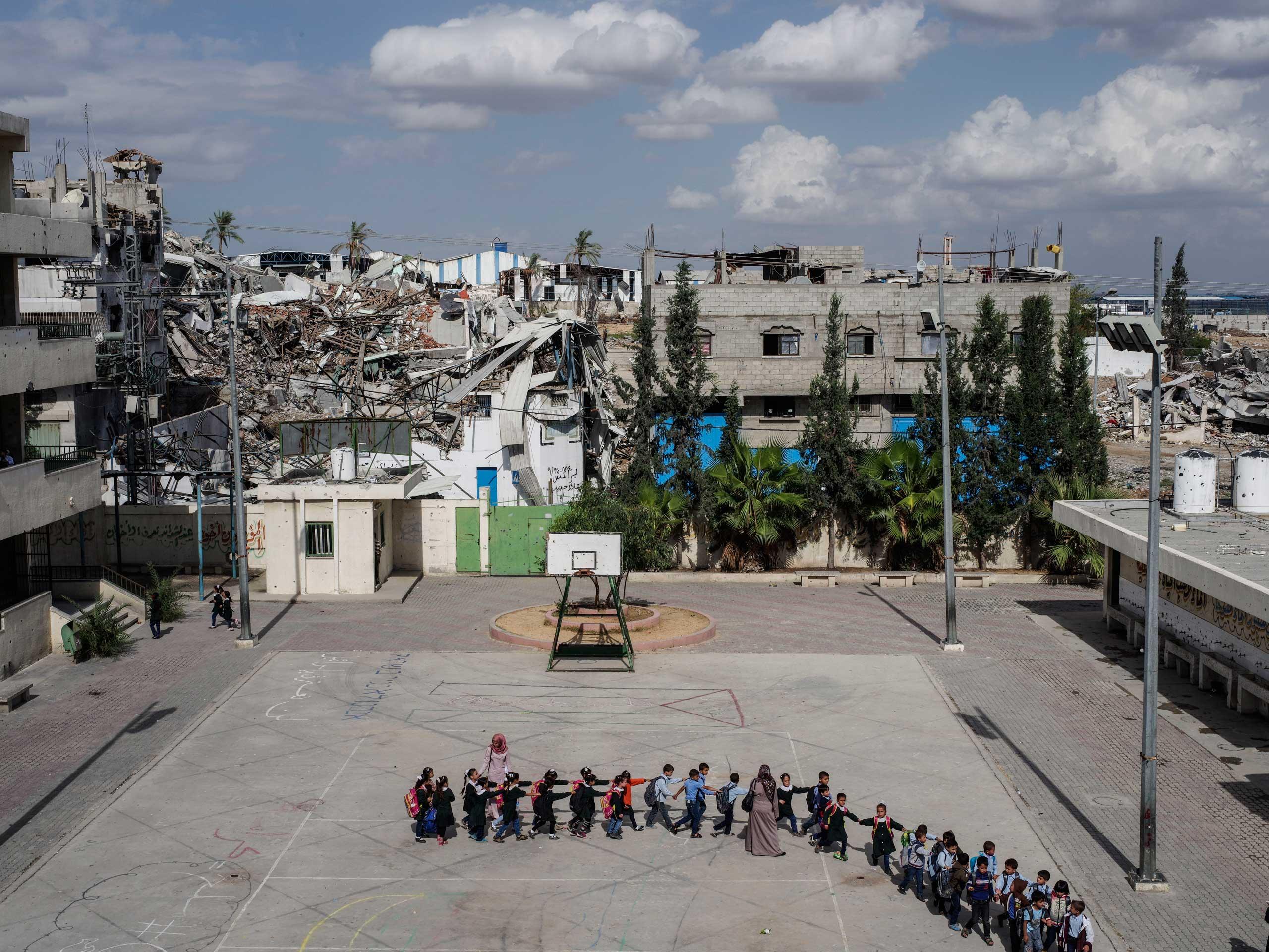 Schoolchildren head to class at the Sobhi Abu Karsh School in the Shujai'iya neighborhood of Gaza, Oct. 20, 2014.