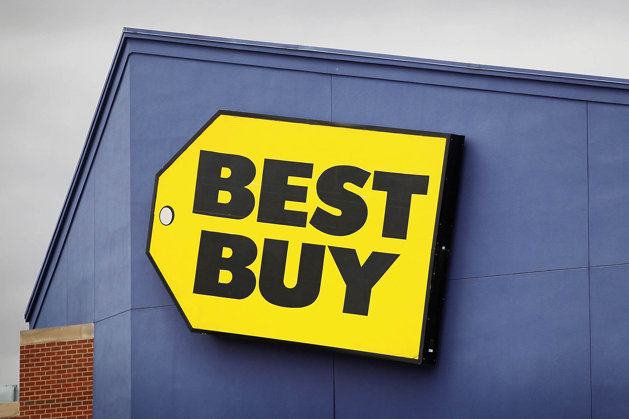 The Best Buy logo hangs above a store on April 16, 2012 in Chicago, Illinois.