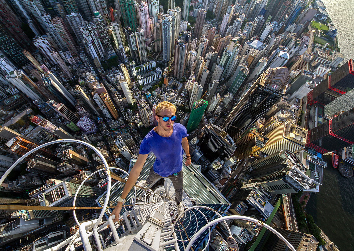Alexander Remnev (@a_remnev) has been rooftopping for 5 years. Hong Kong August 2014