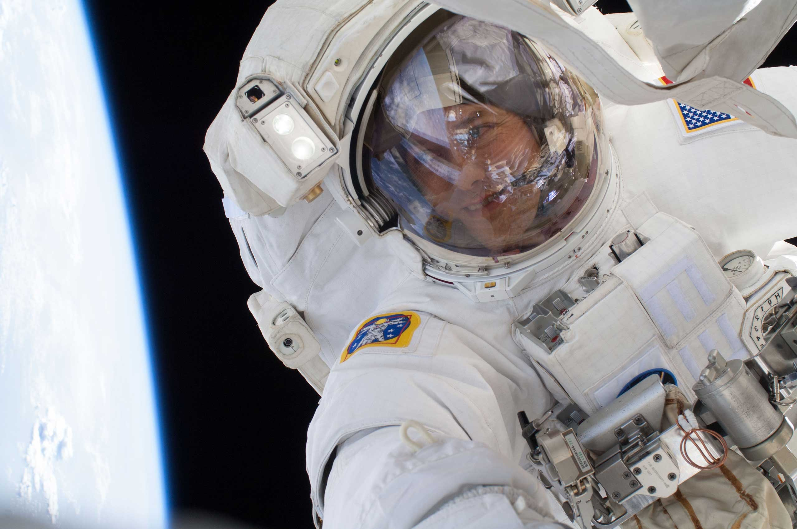 Expedition 35 astronaut Tom Marshburn takes a selfie during a spacewalk on May 11, 2013.