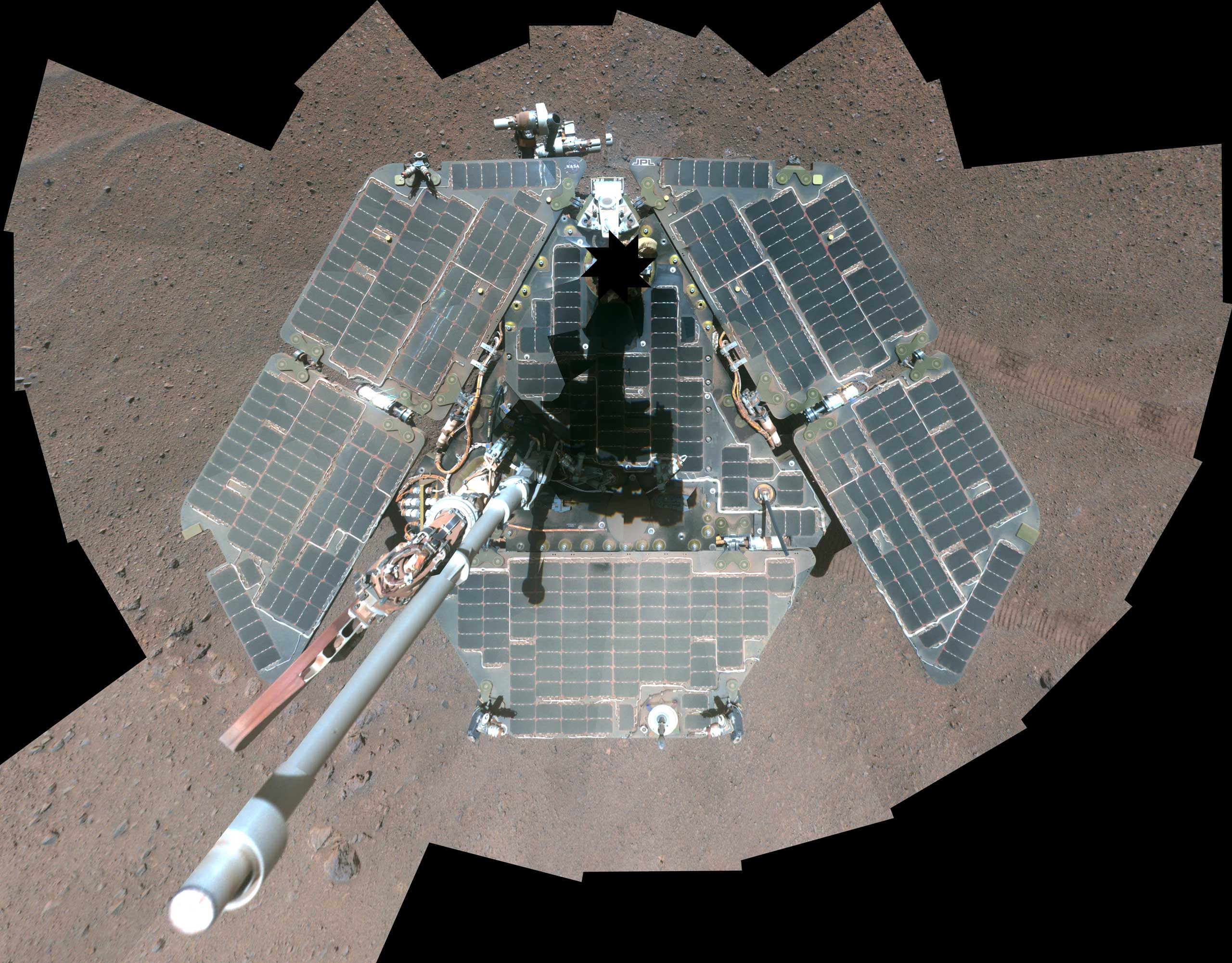 The Opportunity Rover on Mars takes a selfie shortly after dust cleared its solar panels in March 2014.