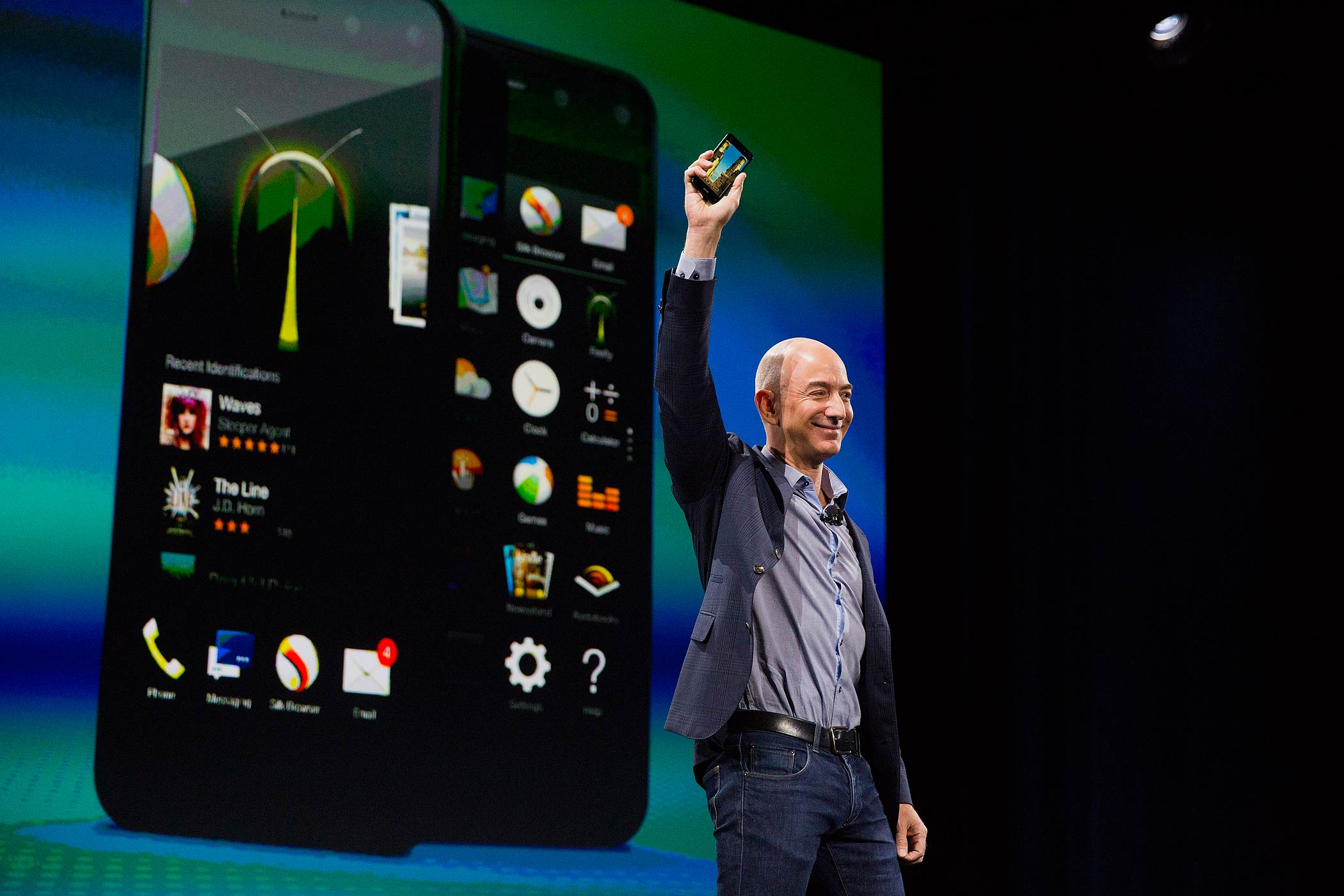 Jeff Bezos, chief executive officer of Amazon, unveils the Fire Phone during an event at Fremont Studios in Seattle, Washington, U.S., on June 18, 2014.