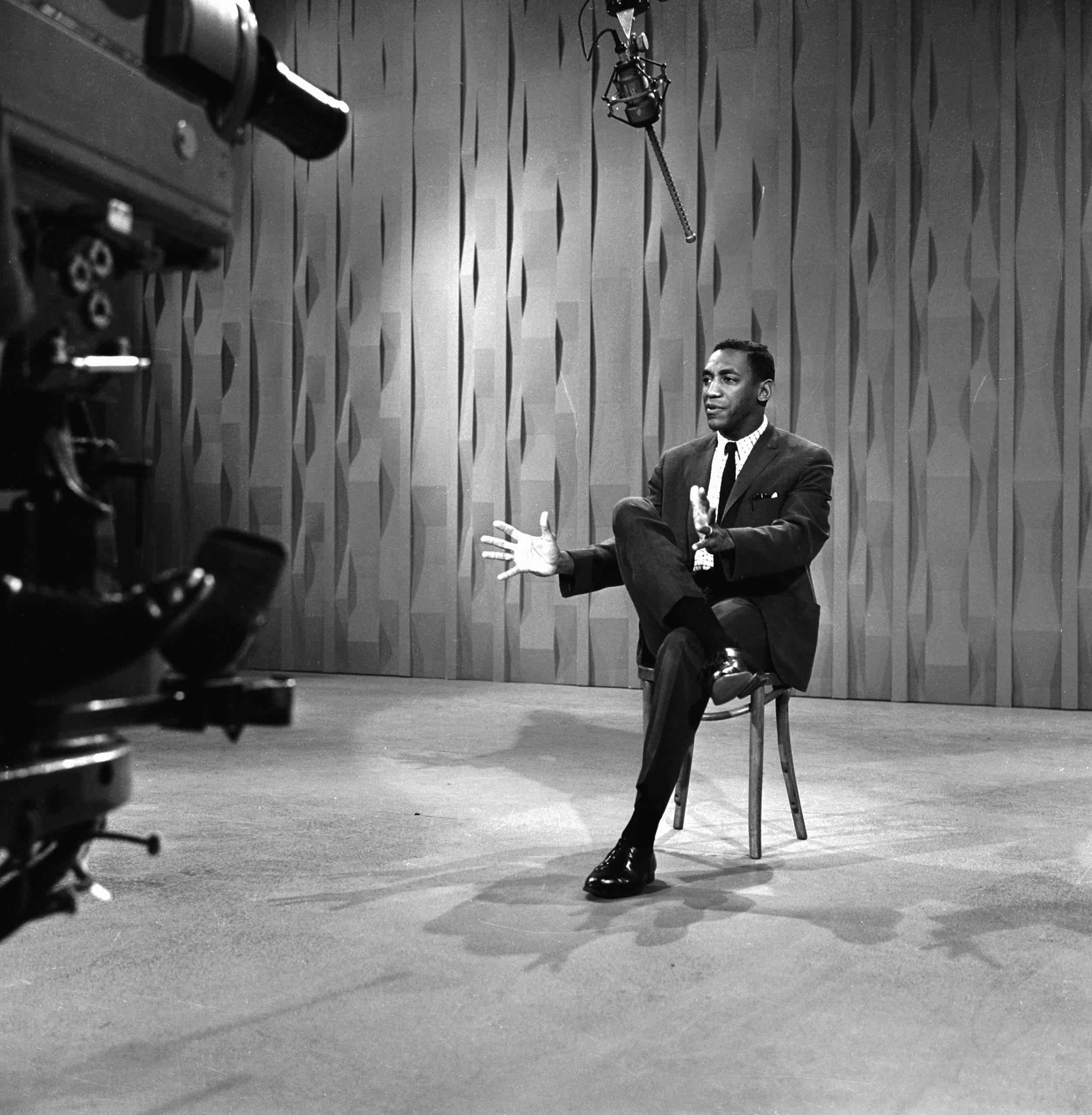 Bill Cosby performs on The Ed Sullivan Show in 1964.