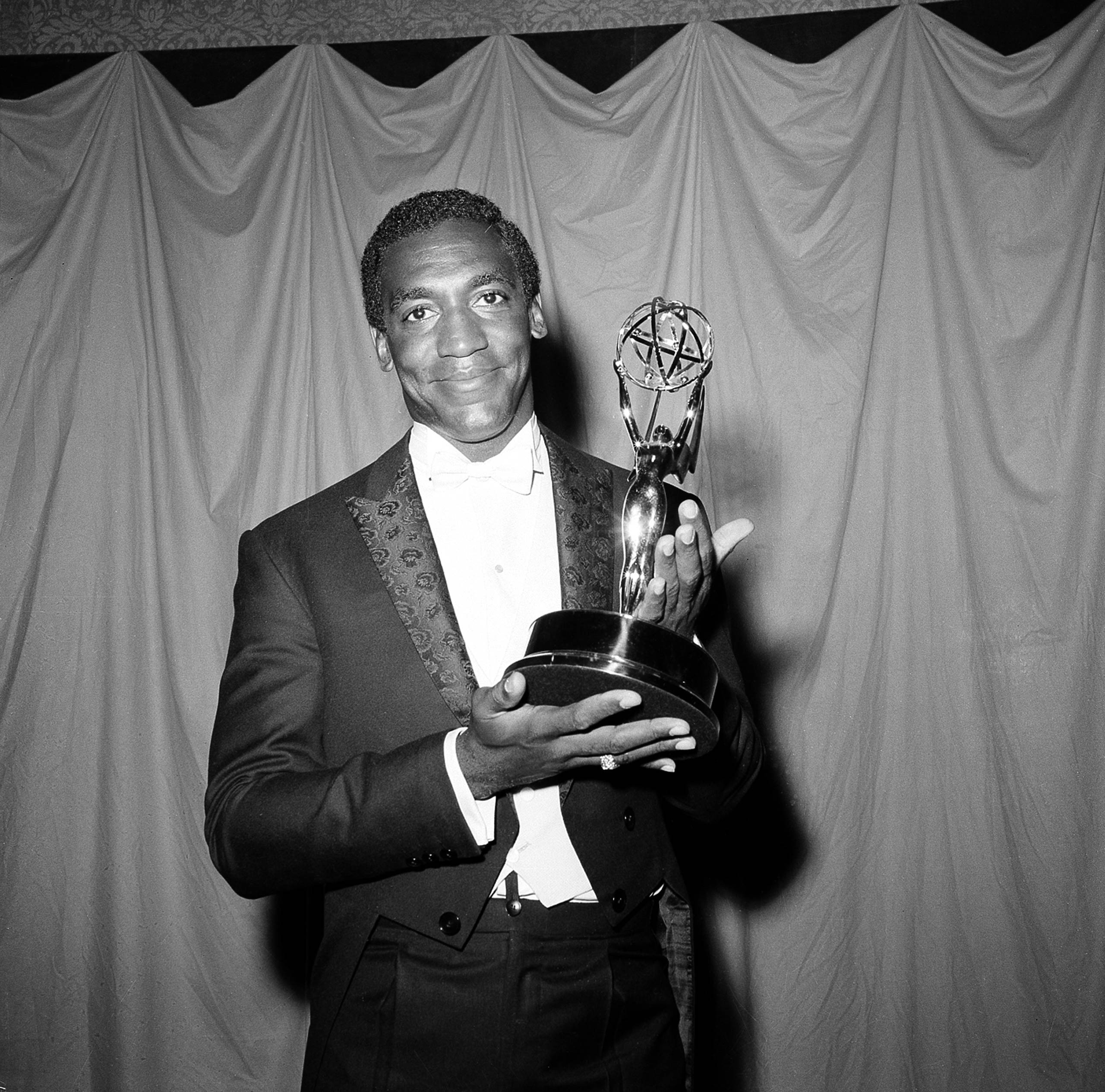 Bill Cosby poses with his Emmy for his role in I Spy at the Primetime Emmy Awards in New York City in 1966.