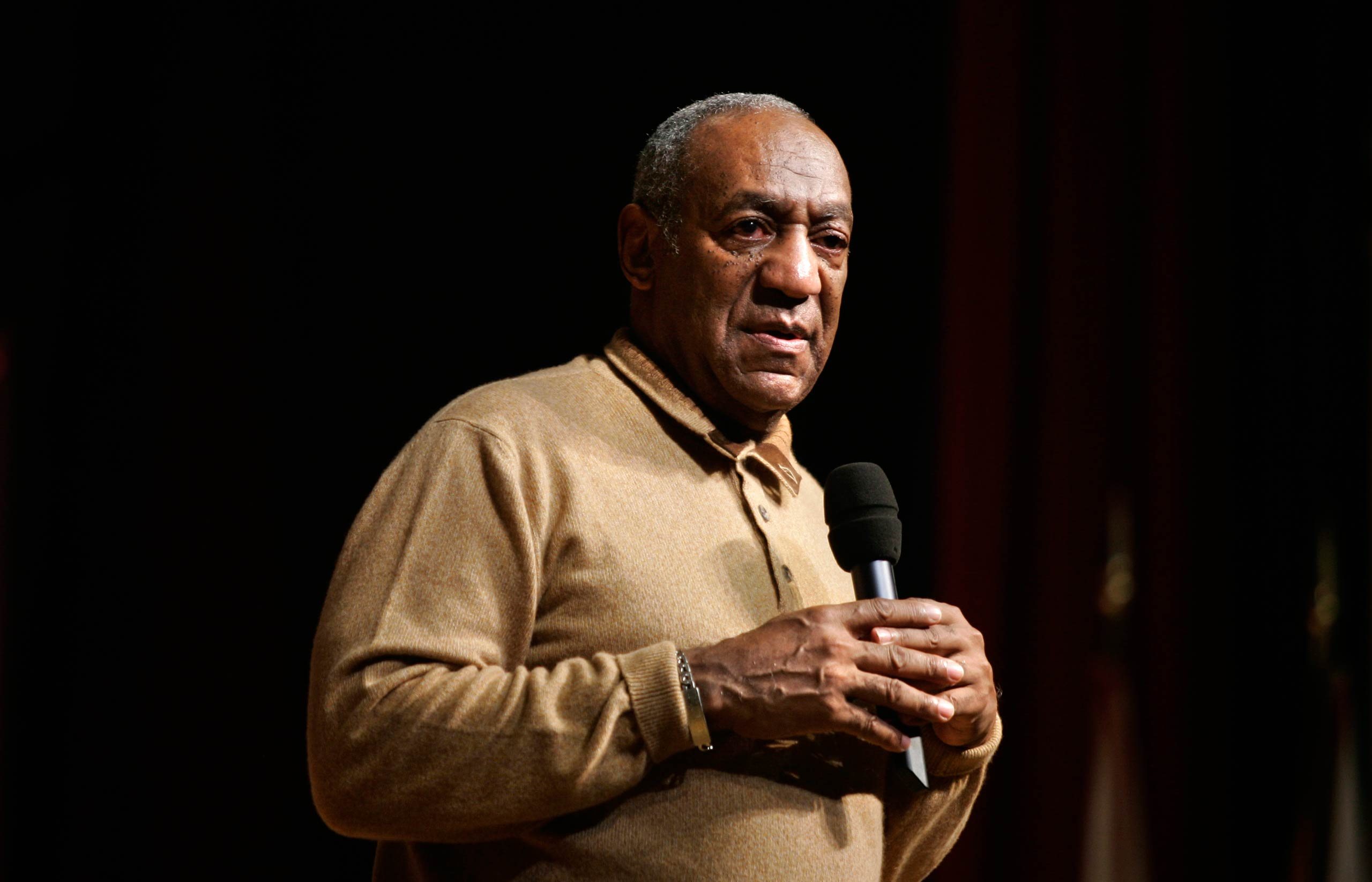 Bill Cosby speaks to an audience on the campus of the University of the District of Columbia in 2006, in Washington D.C.