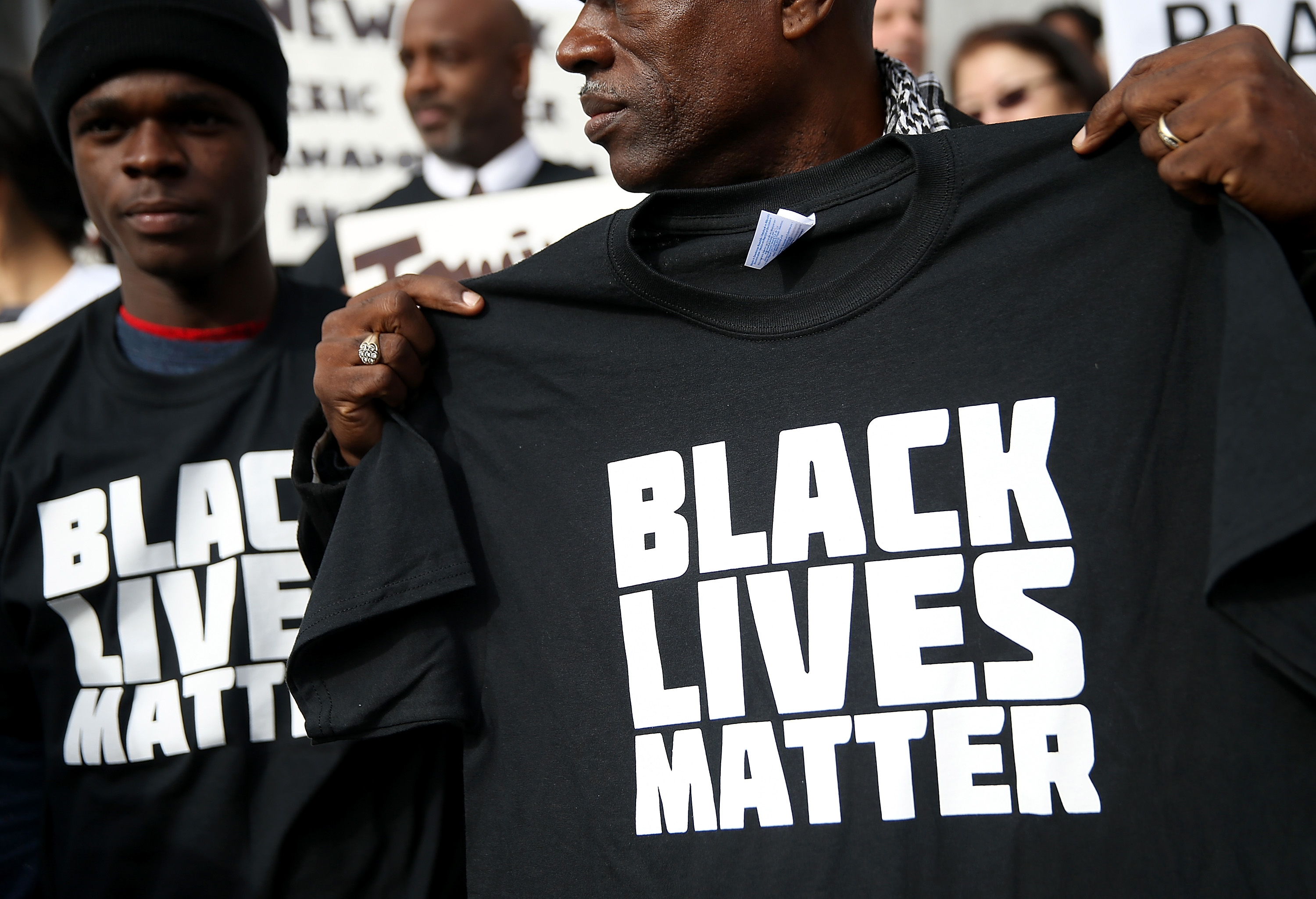 A protestor holds a black lives matter t-shirt during a  Hands Up, Don't Shoot  demonstration in front of the San Francisco Hall of Justice on December 18, 2014 in San Francisco, California.