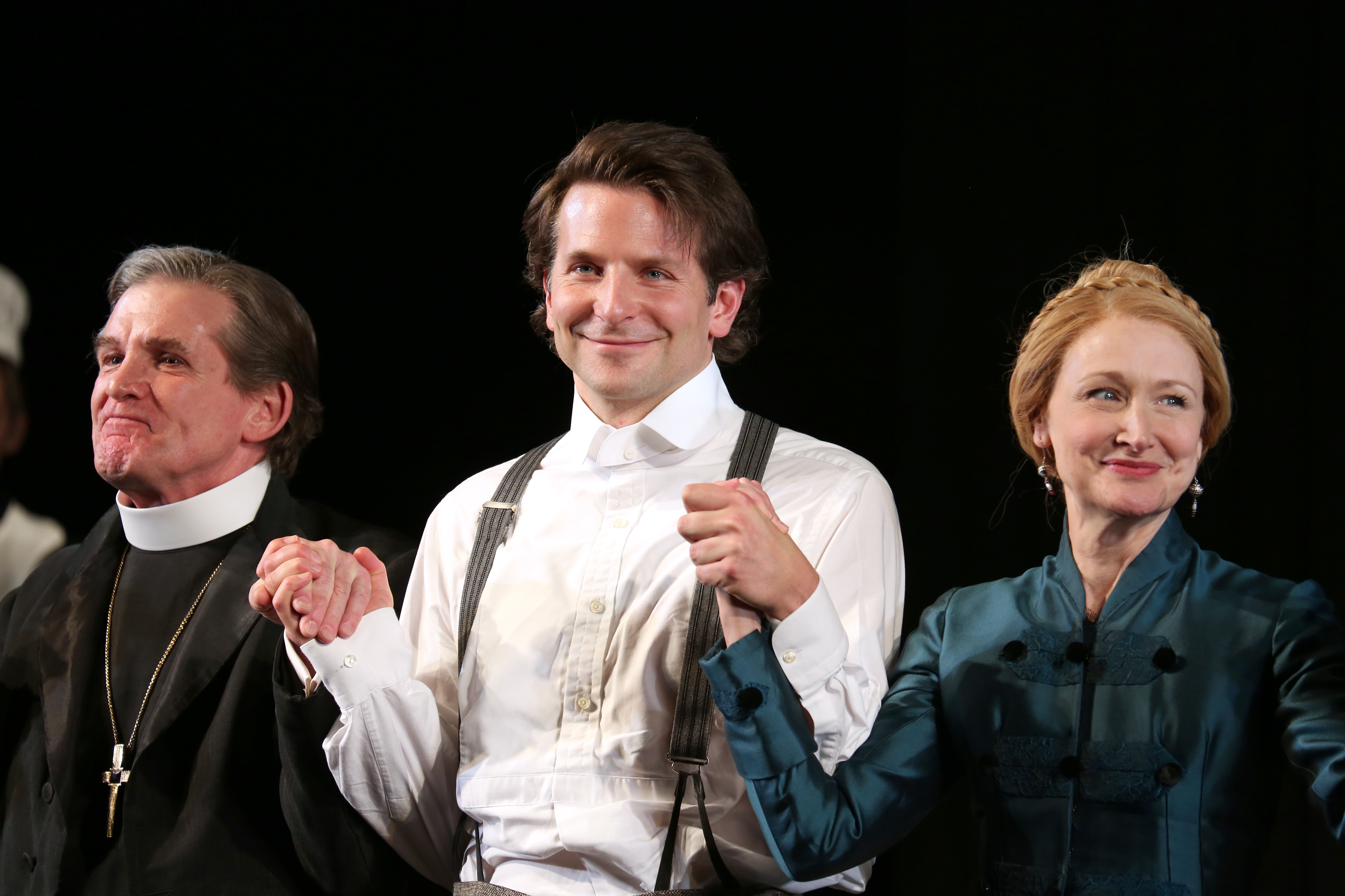 From left: Anthony Heald, Bradley Cooper and Patricia Clarkson during the Broadway opening-night-performance curtain call for The Elephant Man on Dec. 7, 2014, in New York City
