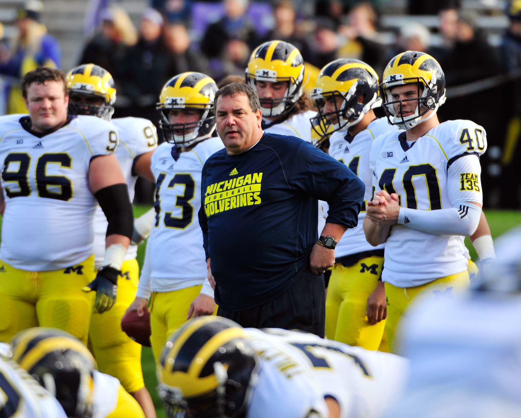 Head coach Brady Hoke of the Michigan Wolverines watches his team warm up before a game against the Northwestern Wildcats on November 8, 2014 at Ryan Field in Evanston, Illinois.