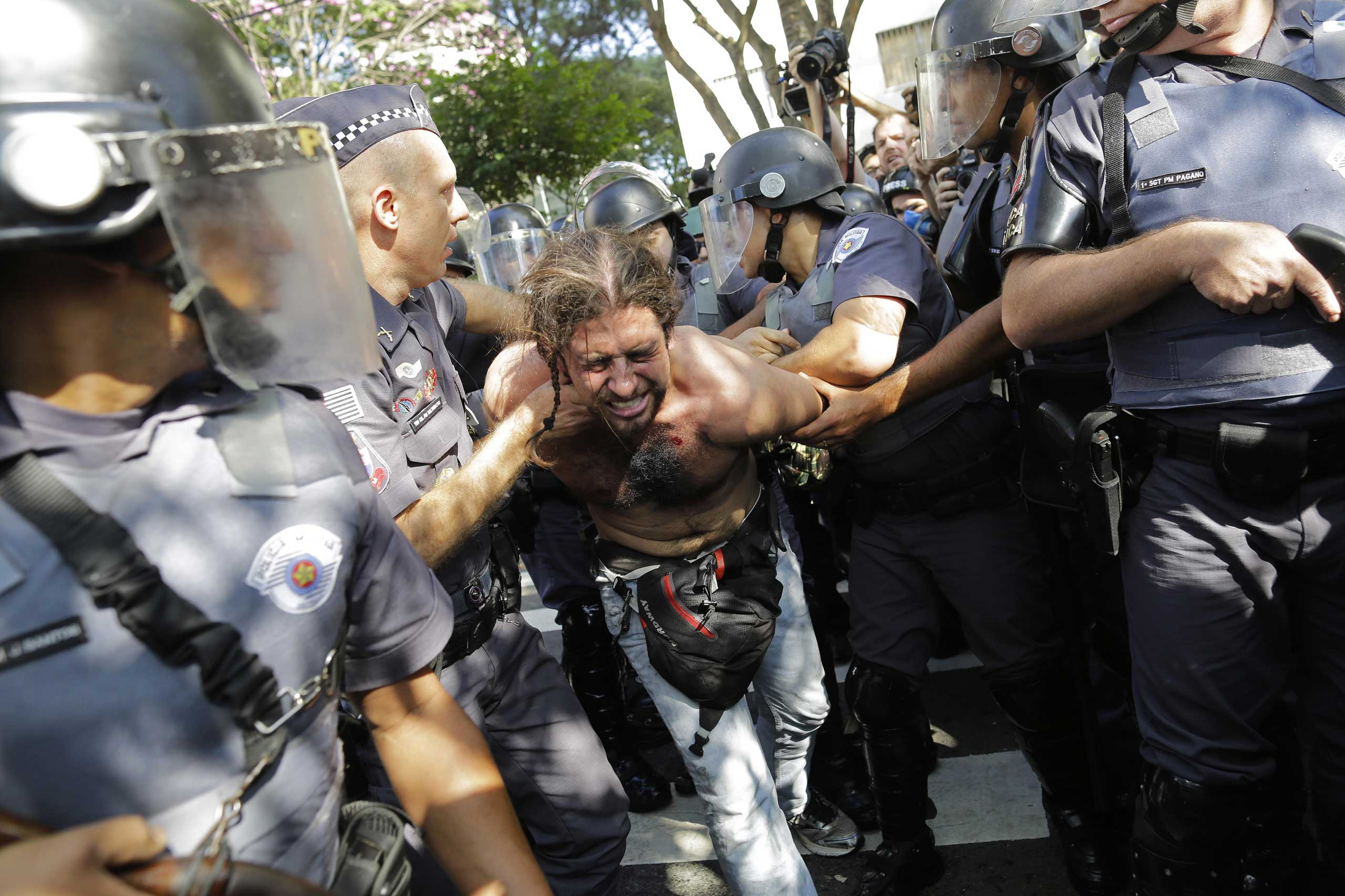 Brazil: Protest against public spending on World CupA protester is detained by police during a demonstration by people demanding better public services and against the money spent on the World Cup soccer tournament in Sao Paulo, June 12, 2014.