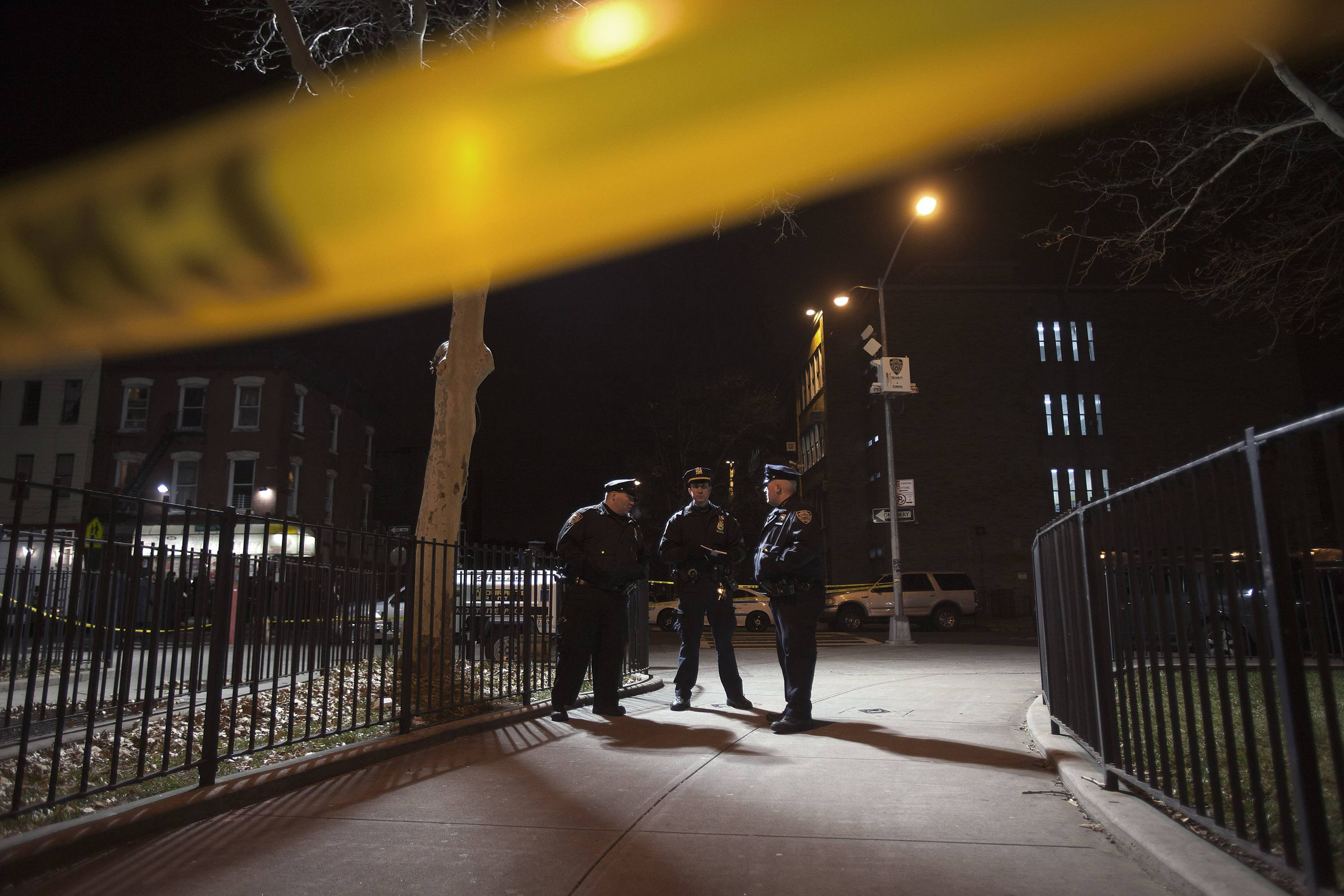 Police are pictured at the scene of a shooting where two New York Police officers were shot dead in the Brooklyn borough of New York City on Dec. 20, 2014.