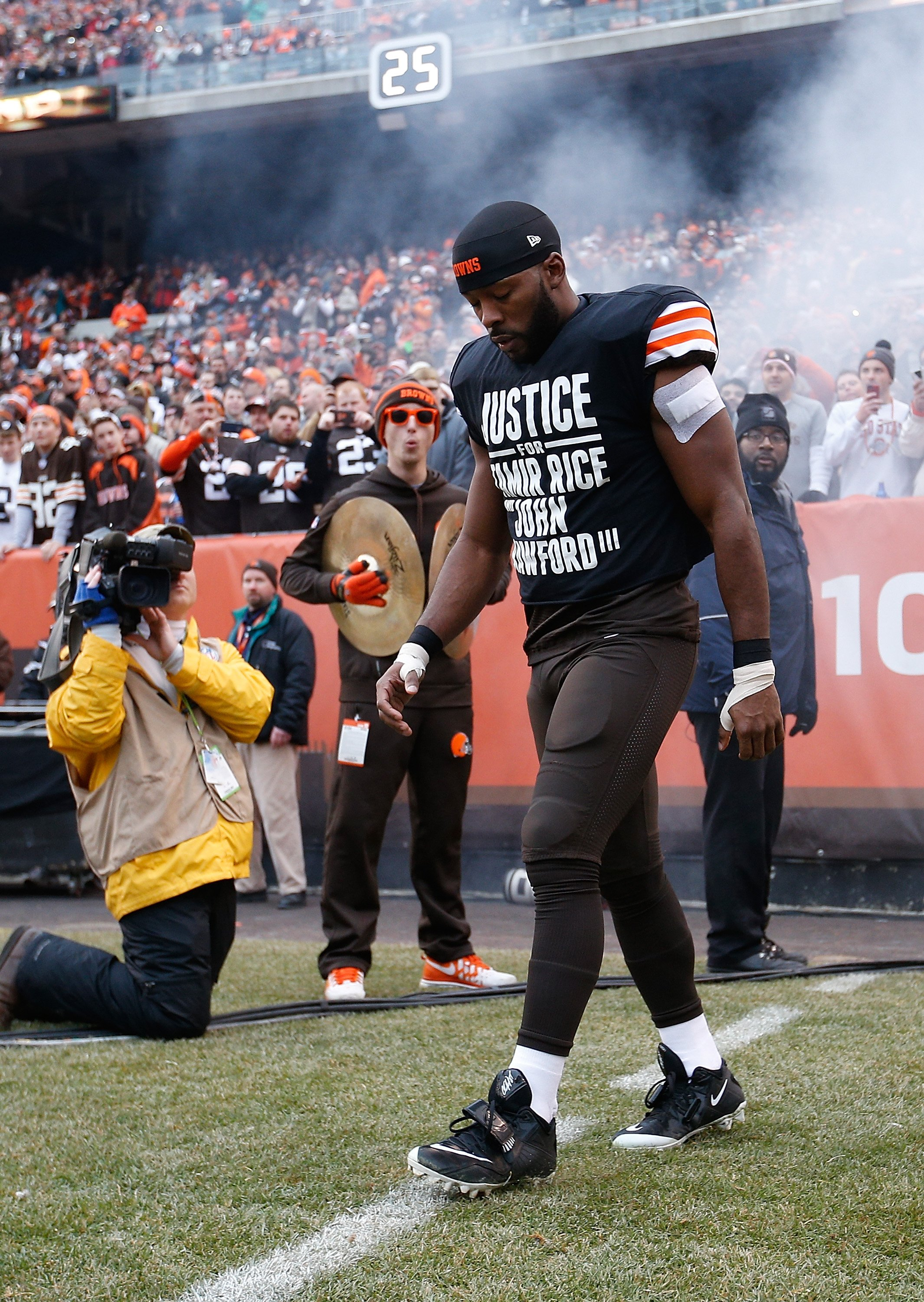 Andrew Hawkins #16 of the Cleveland Browns walks onto the field while wearing a protest shirt during introductions prior to the game against the Cincinnati Bengals at FirstEnergy Stadium on Dec. 14, 2014 in Cleveland.
