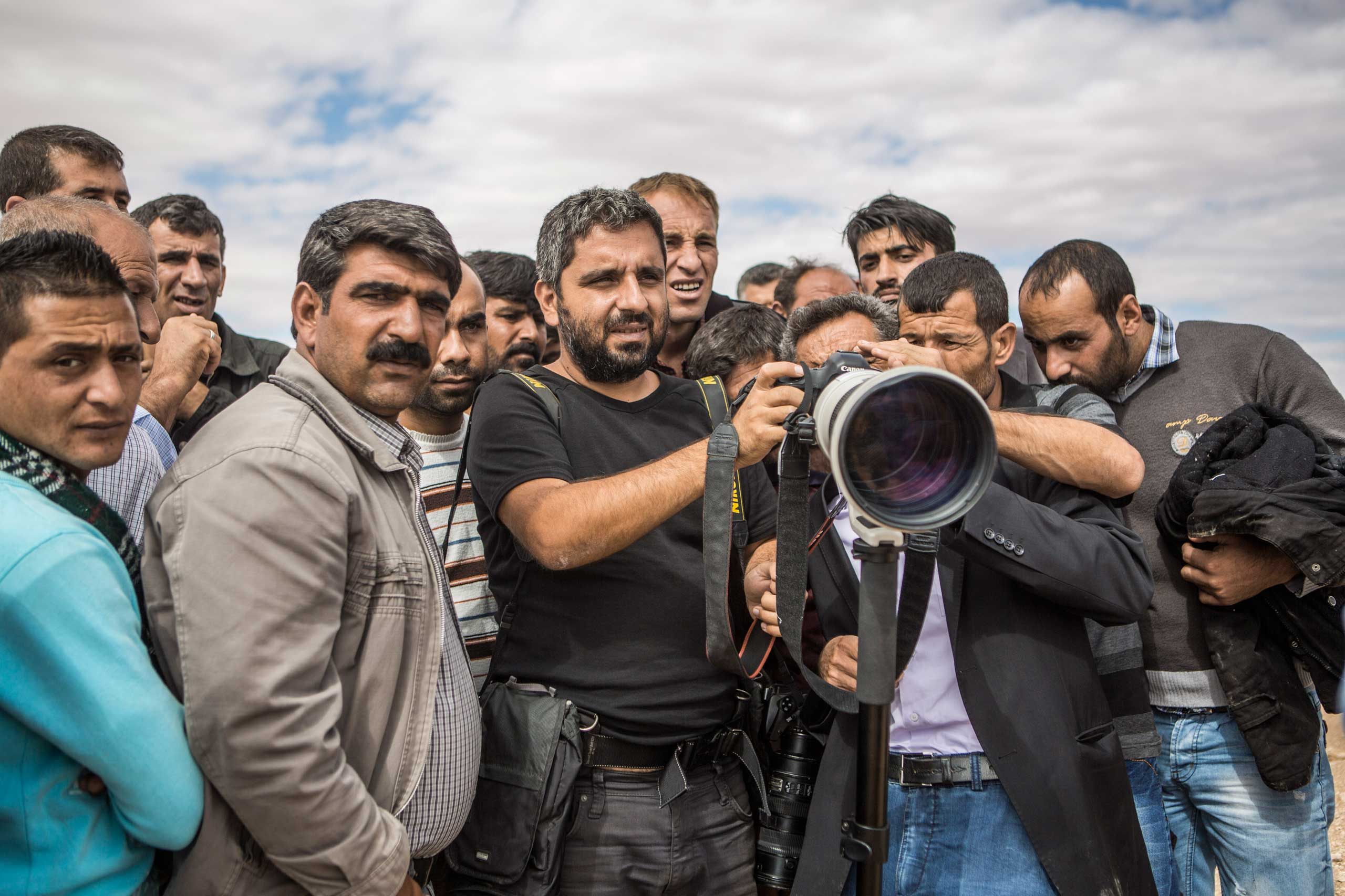Bulent Kilic (center), TIME's 2014 Wire Photographer of the Year, in Turkey.