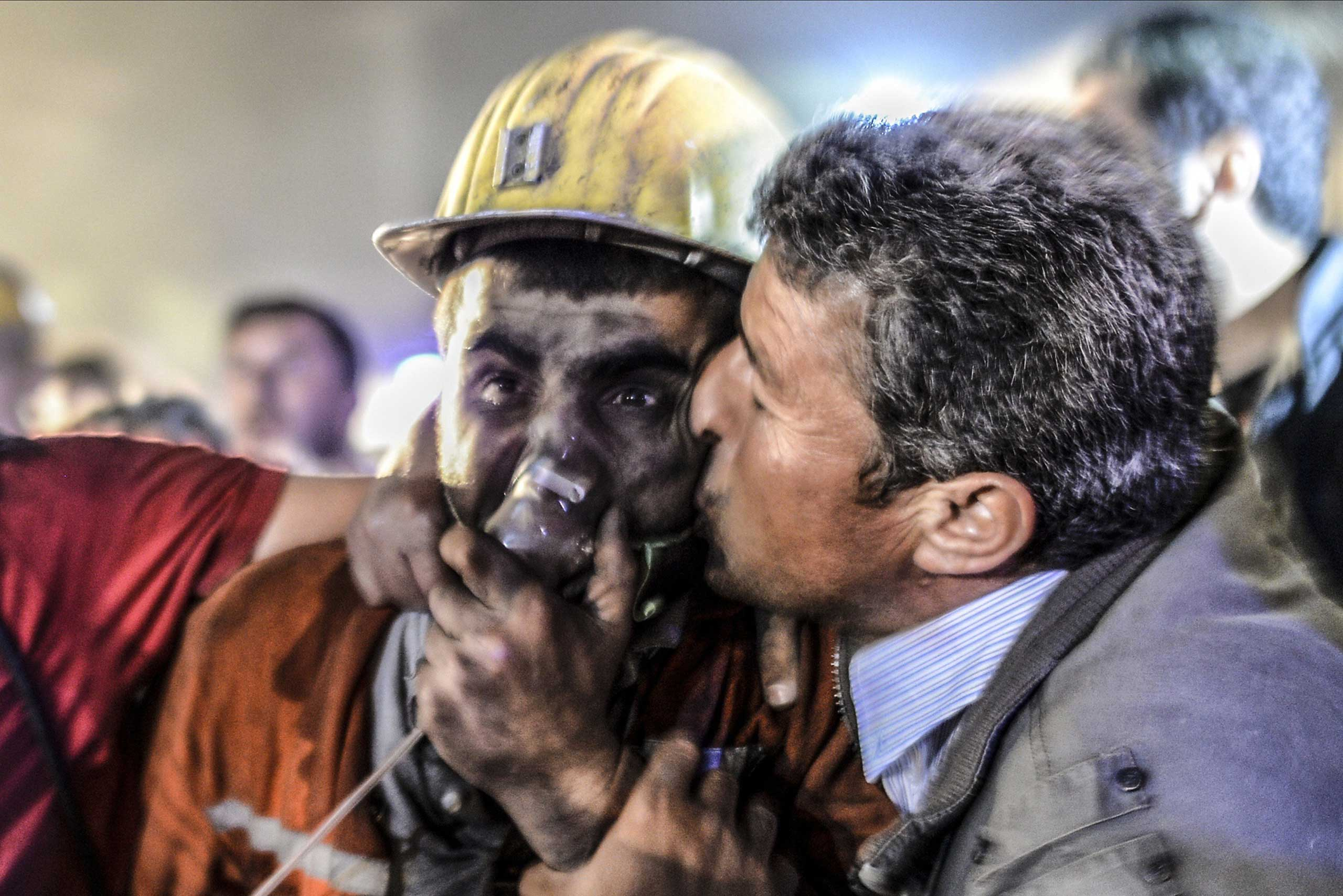 A man kisses his rescued son on May 13, 2014 after an explosion in a coal mine in Manisa, Turkey