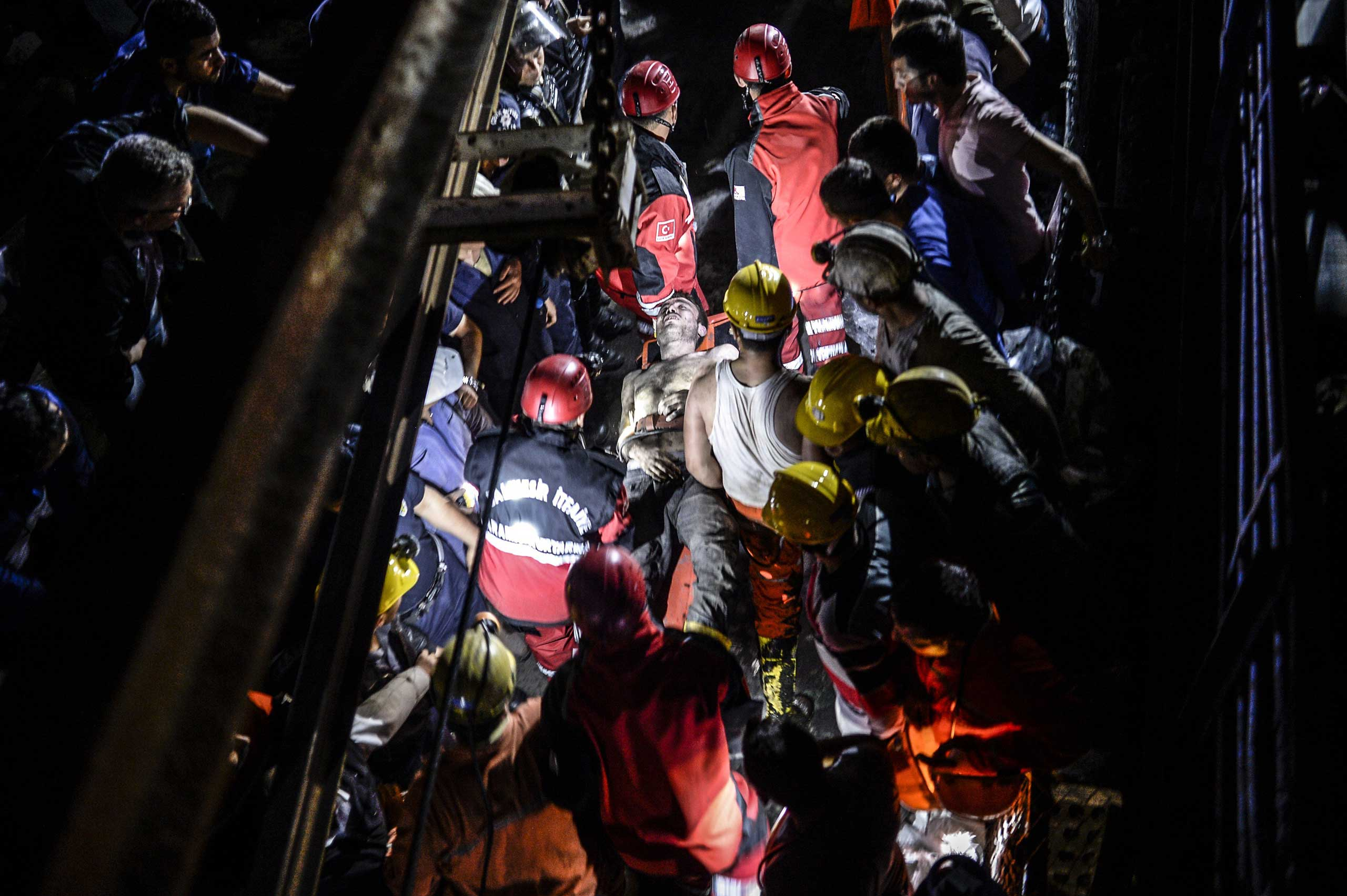 An injured miner comes out, carried by rescuers after an explosion in Manisa, Turkey, on May 13, 2014.