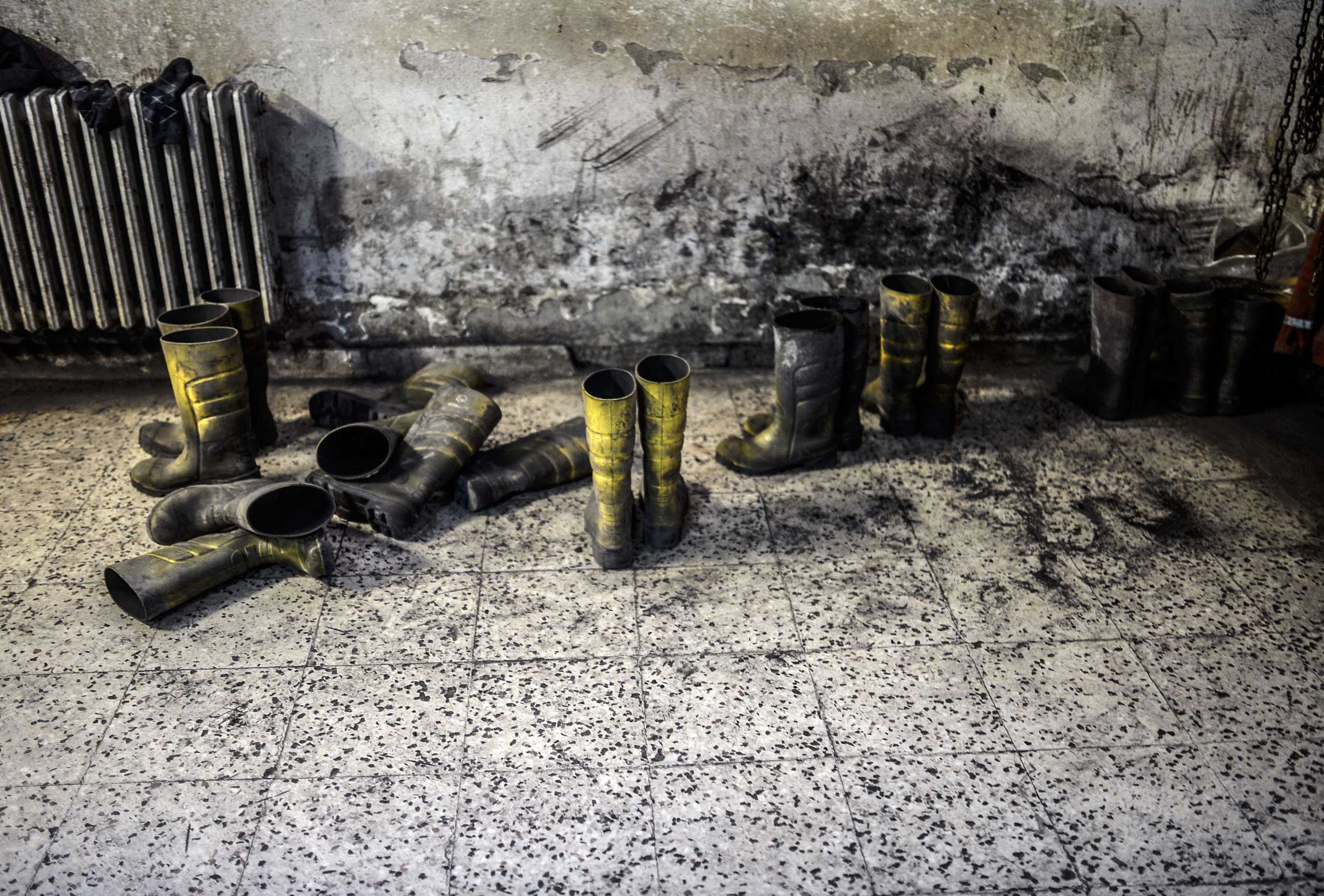 Boots of miners are pictured in an outside building at a mine in Manisa on May 14, 2014.