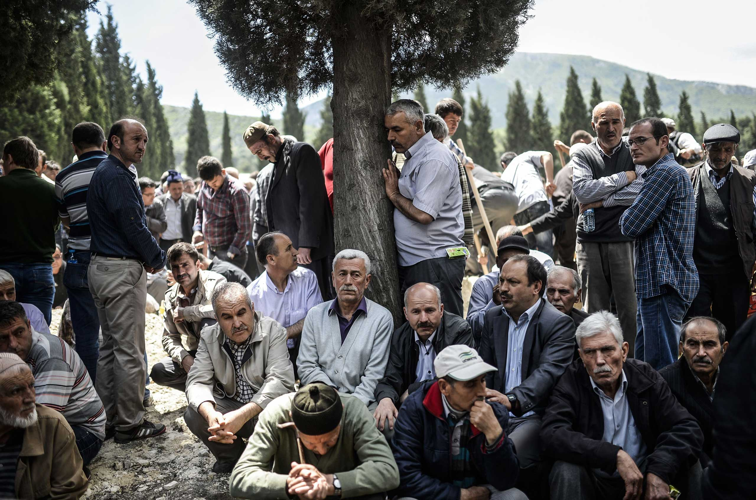 People mourn in a cemetery during the funeral ceremony of miners who died in an explosion on May 15, 2014, in the western town of Soma in the Manisa province, Turkey.