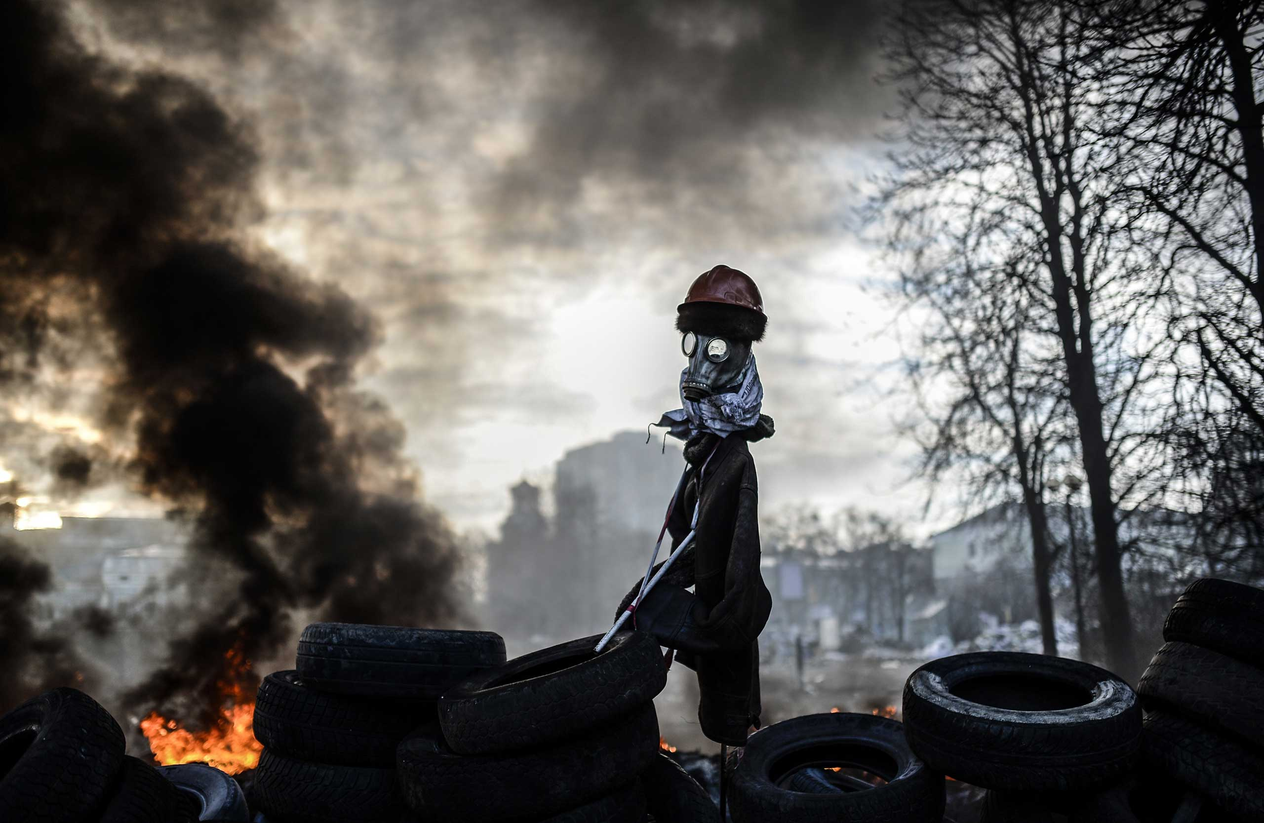 A scarecrow like mock anti-government protestor is pictured on a barricade between protestors and government forces on Feb. 21, 2014 in Kiev, Ukraine.