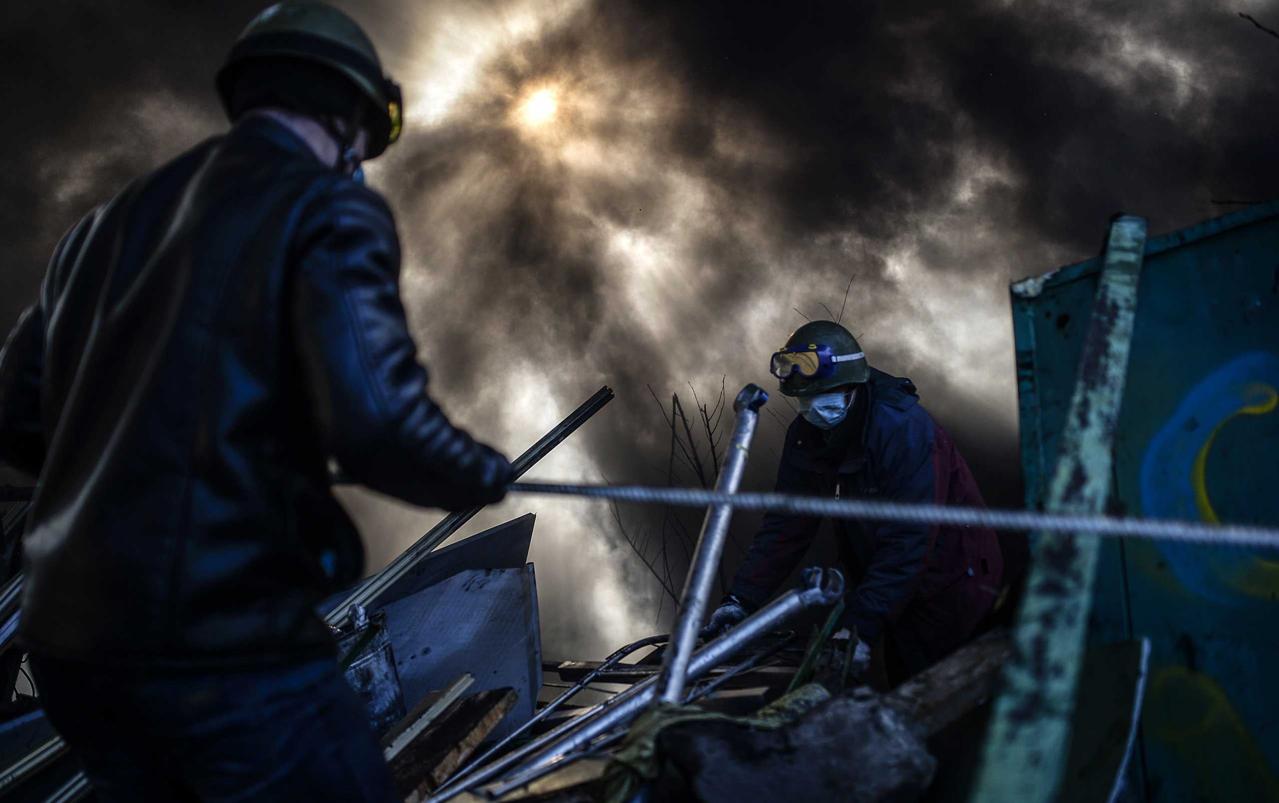 Protesters build a barricade early in the morning on Feb. 21, 2014 at the Independent square in Kiev, Ukraine.