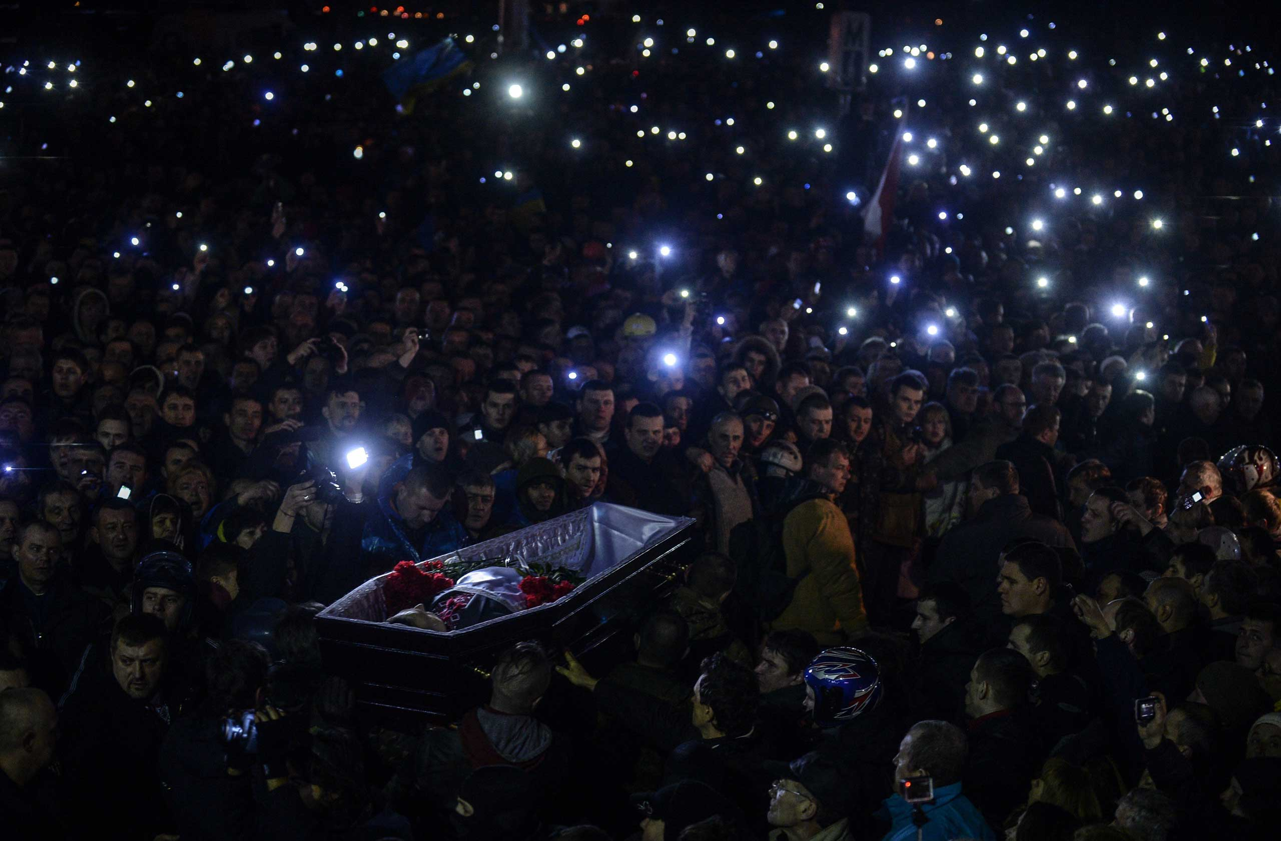 People carry a coffin of a man who was killed during clashes, as they gather on Independence Square in Kiev, Ukraine, on Feb. 22, 2014.