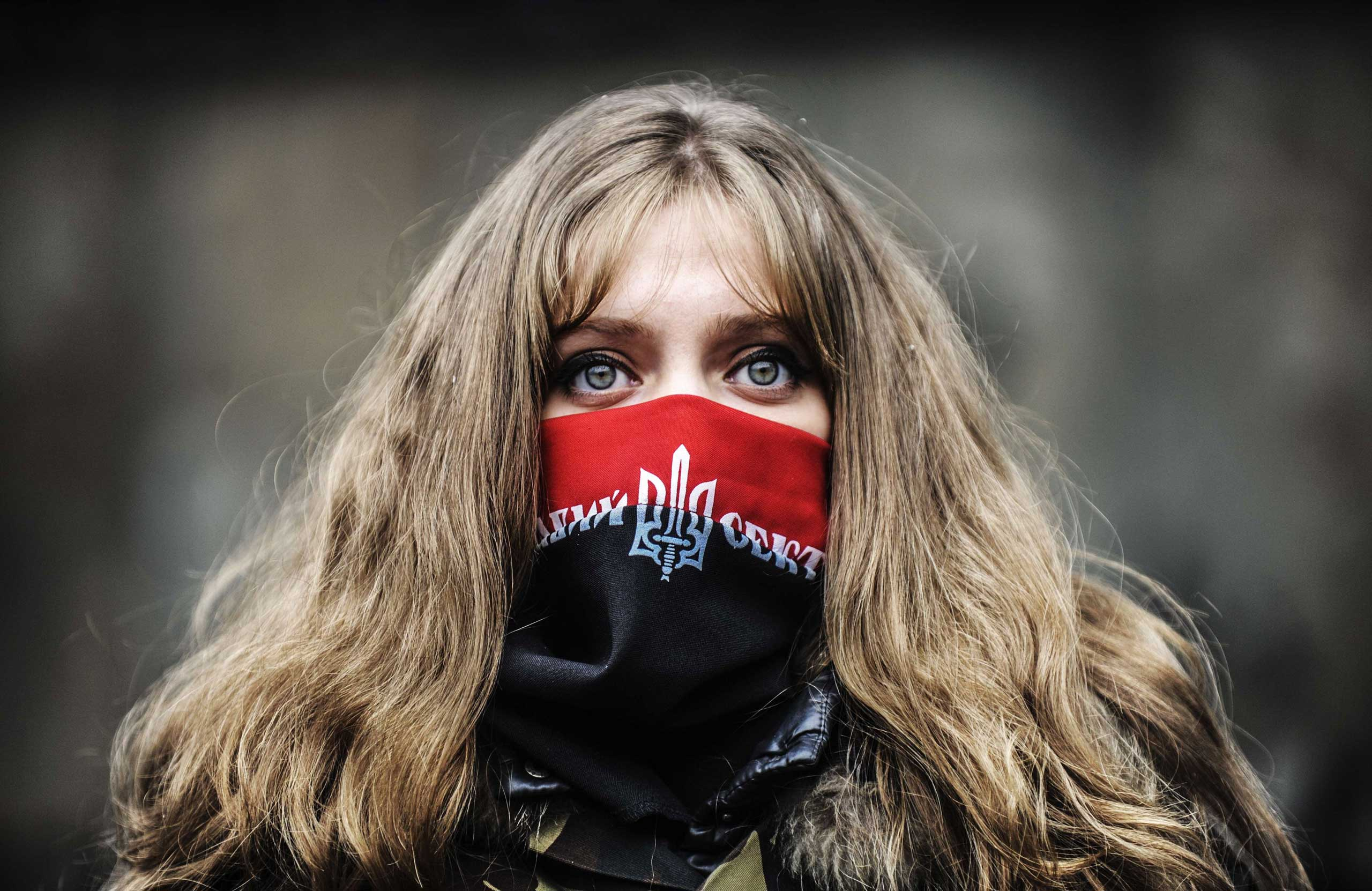 An anti-government protestor waits at the entrance of Independence square in Kiev, Ukraine, on Feb. 23, 2014.