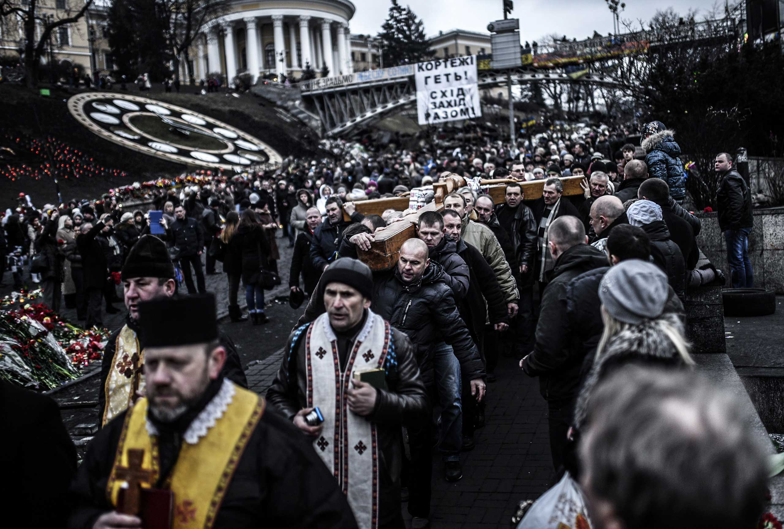 People hold a large crucifix during a procession on Independence square in Kiev, Ukraine, on Feb. 25, 2014.