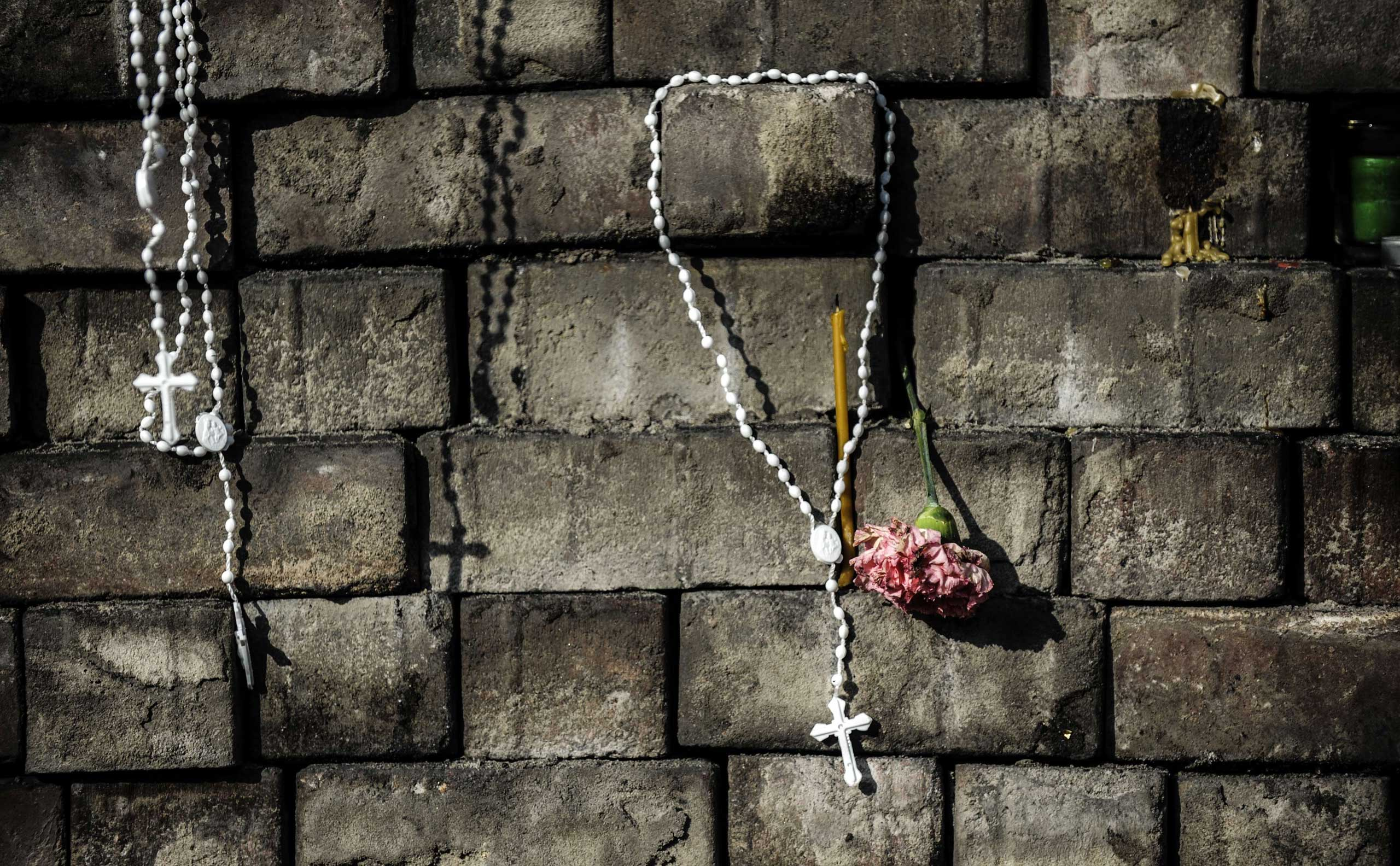 Crosses and flowers left by people near a makeshift memorial in homage to anti-government protesters killed in the clashes with riot police on Independence Square in Kiev, Ukraine, on Feb. 24, 2014.