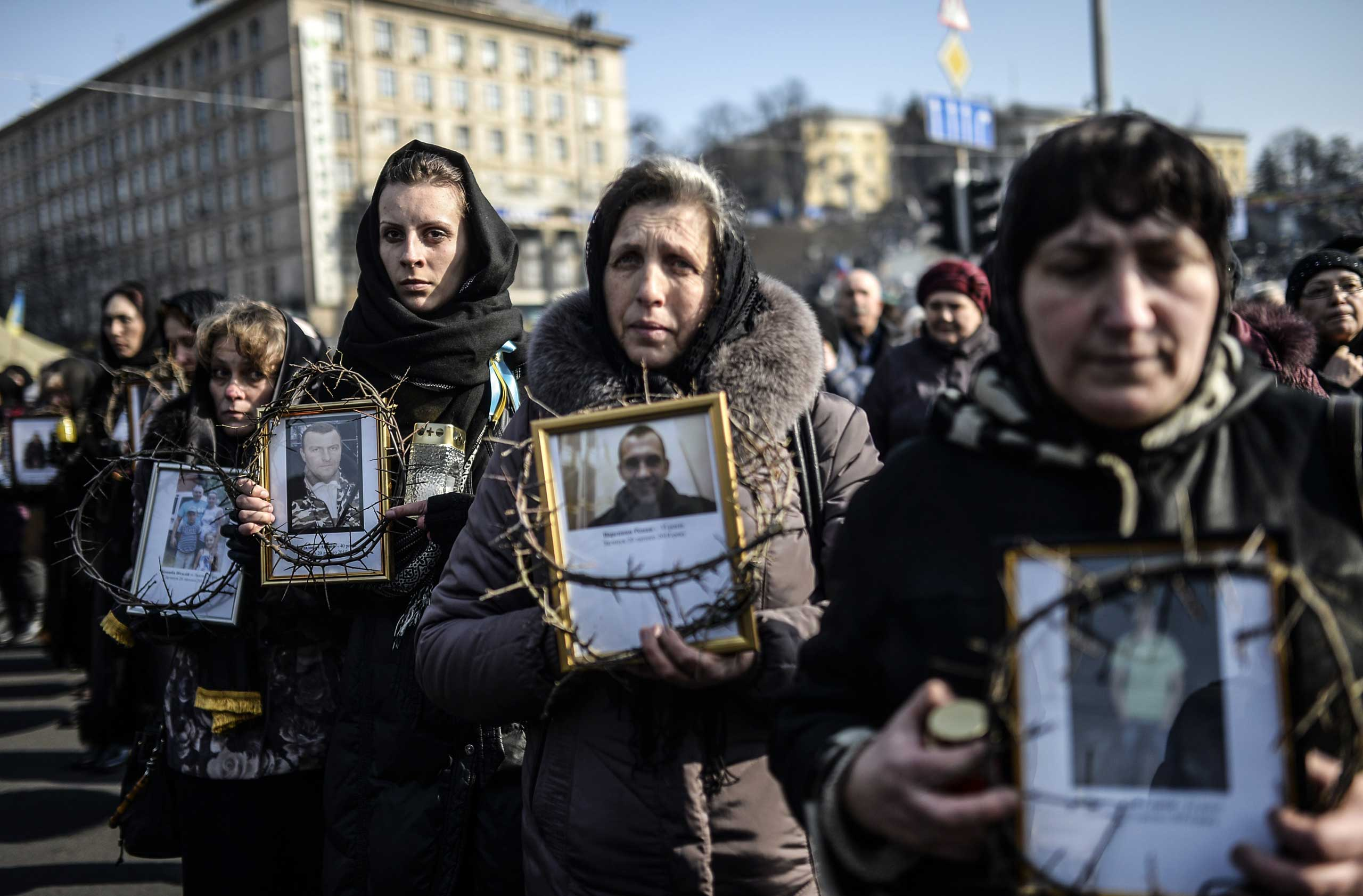 Women hold pictures of protesters who were killed in clashes with police during demonstrations in Kiev, Ukraine, on Feb. 26, 2014.