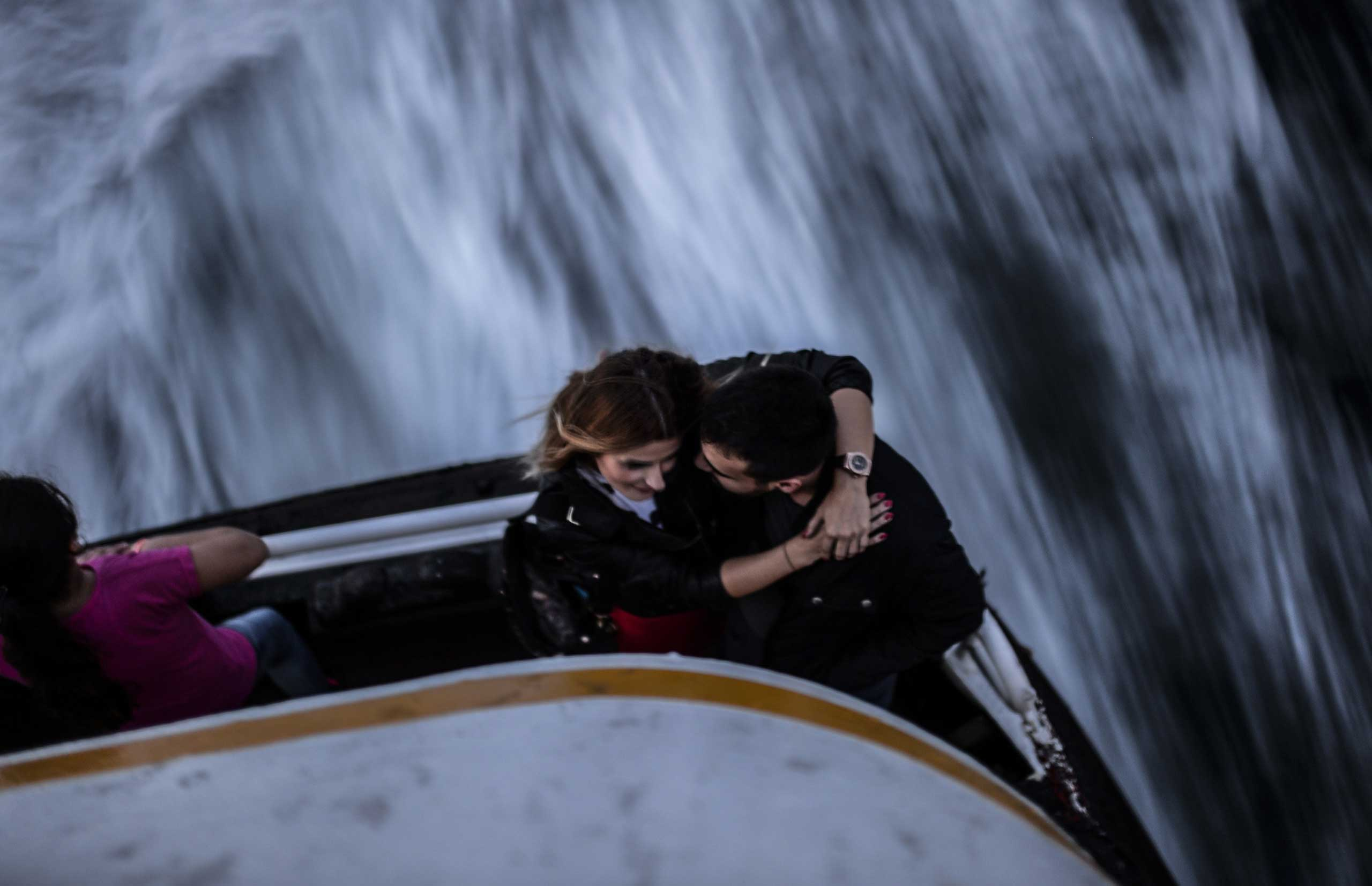 A Turkish couple shares a romantic sunset on a ferry on the Bosphorus, in Istanbul, Turkey, on Oct. 17, 2014.